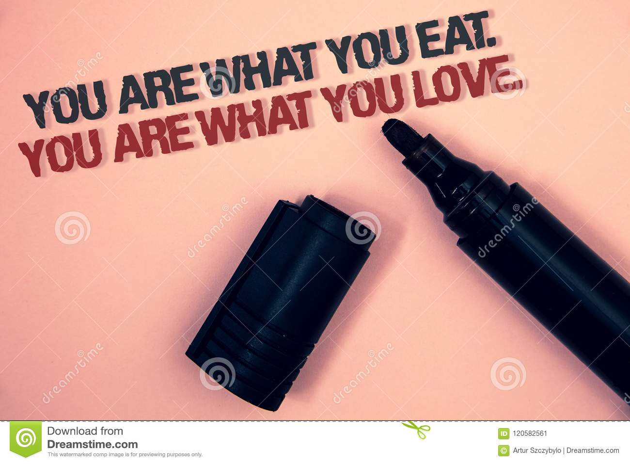 Text sign showing You Are What You Eat. You Are What You Love.. Conceptual photo Start to eat healthy food Pinkish platform black
