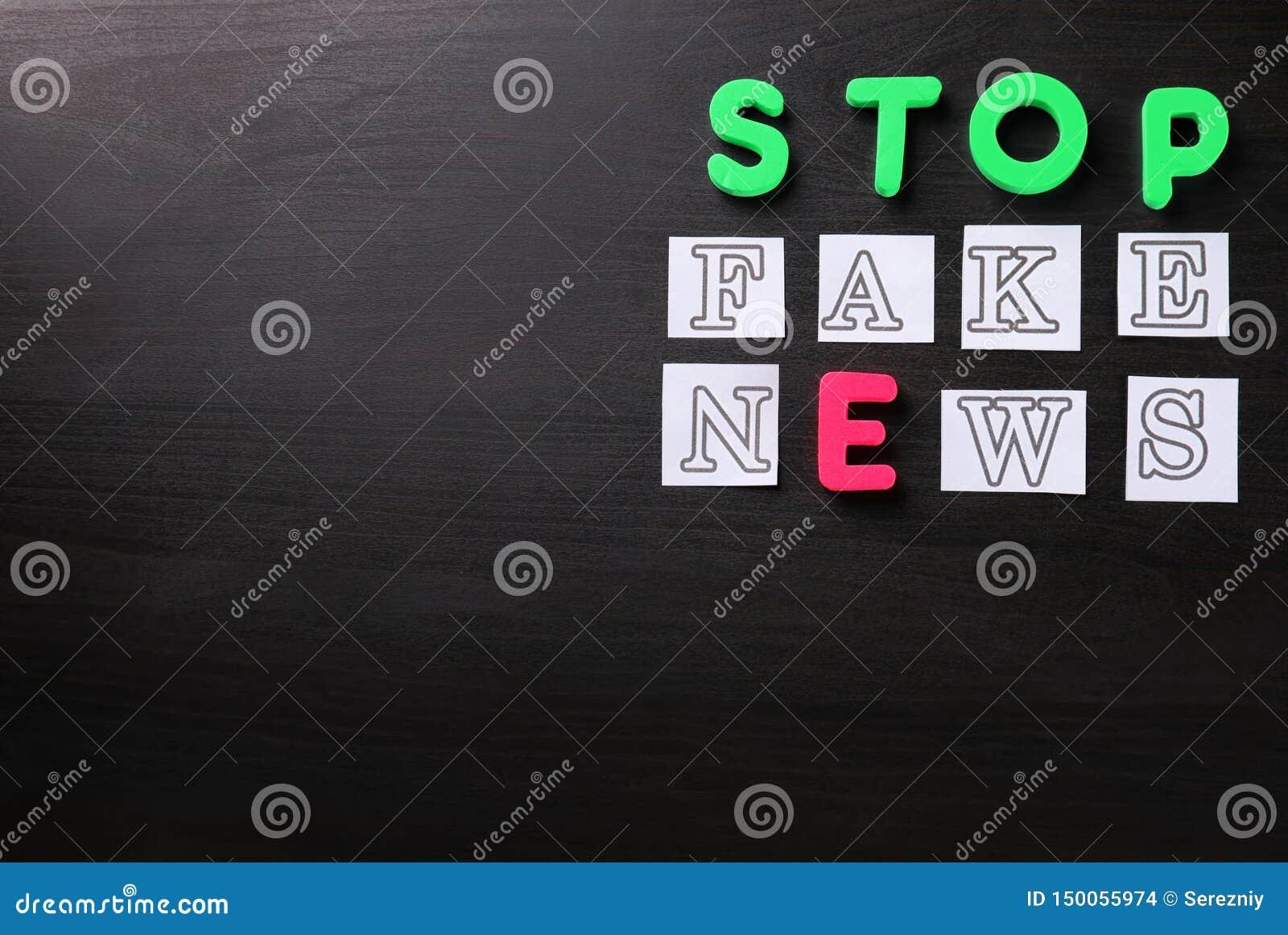 Text STOP FAKE NEWS on dark background