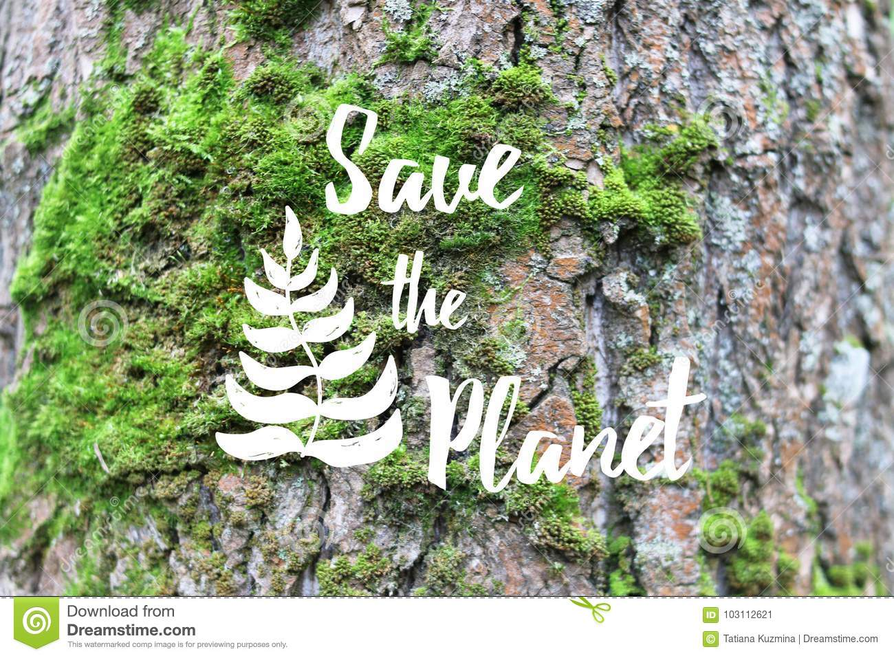 Inspirational text Save the planet on the tree bark