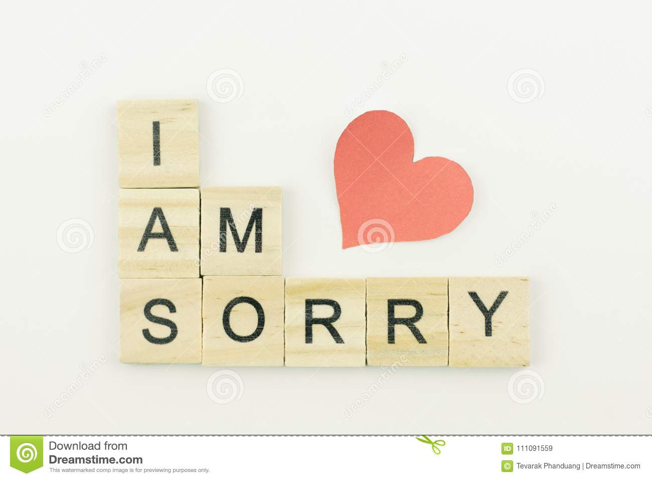 text wooden blocks spelling the word i am sorry on white backgro
