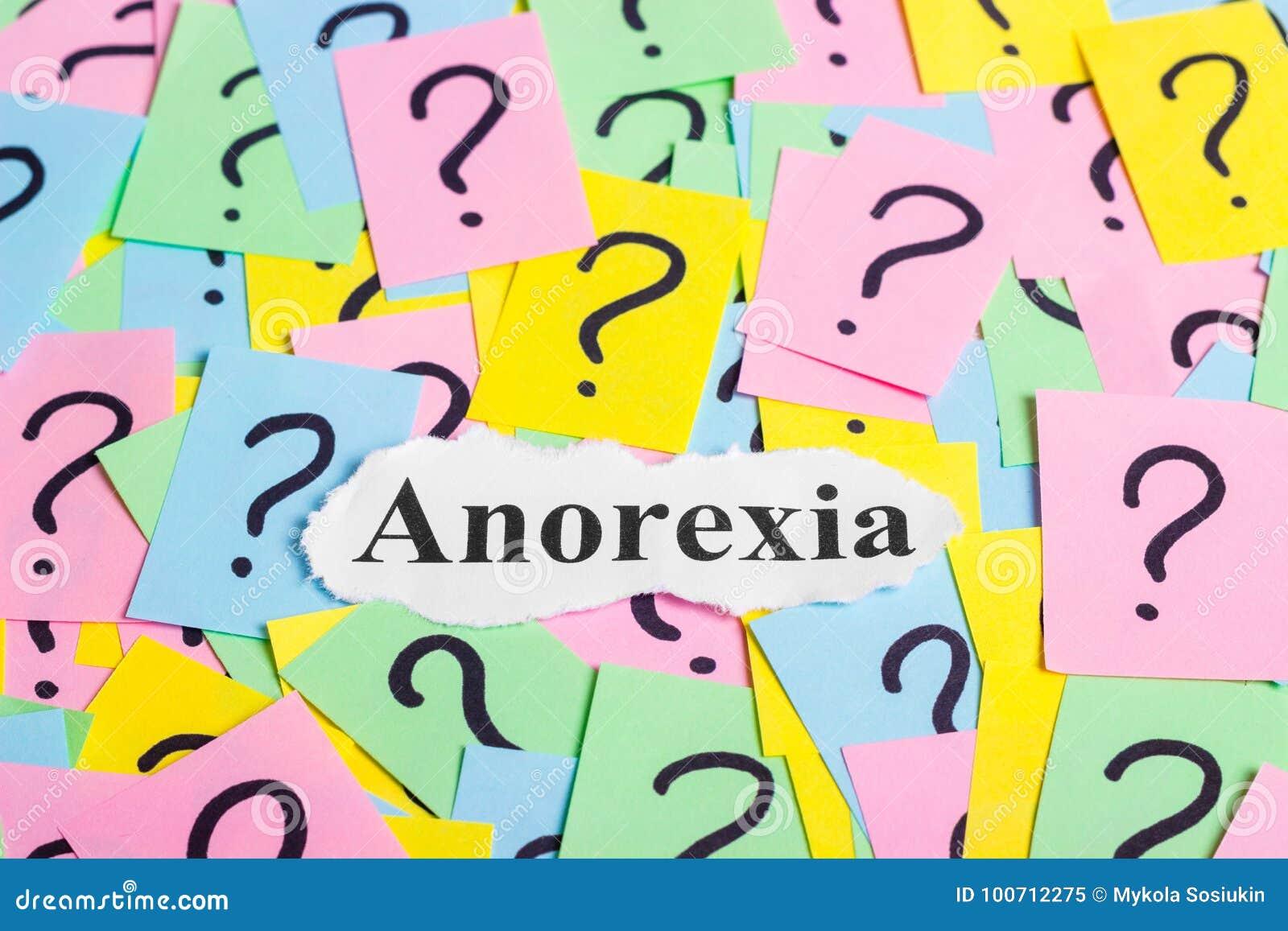 Texte de syndrome d anorexie sur les notes collantes colorées dans la perspective des points d interrogation