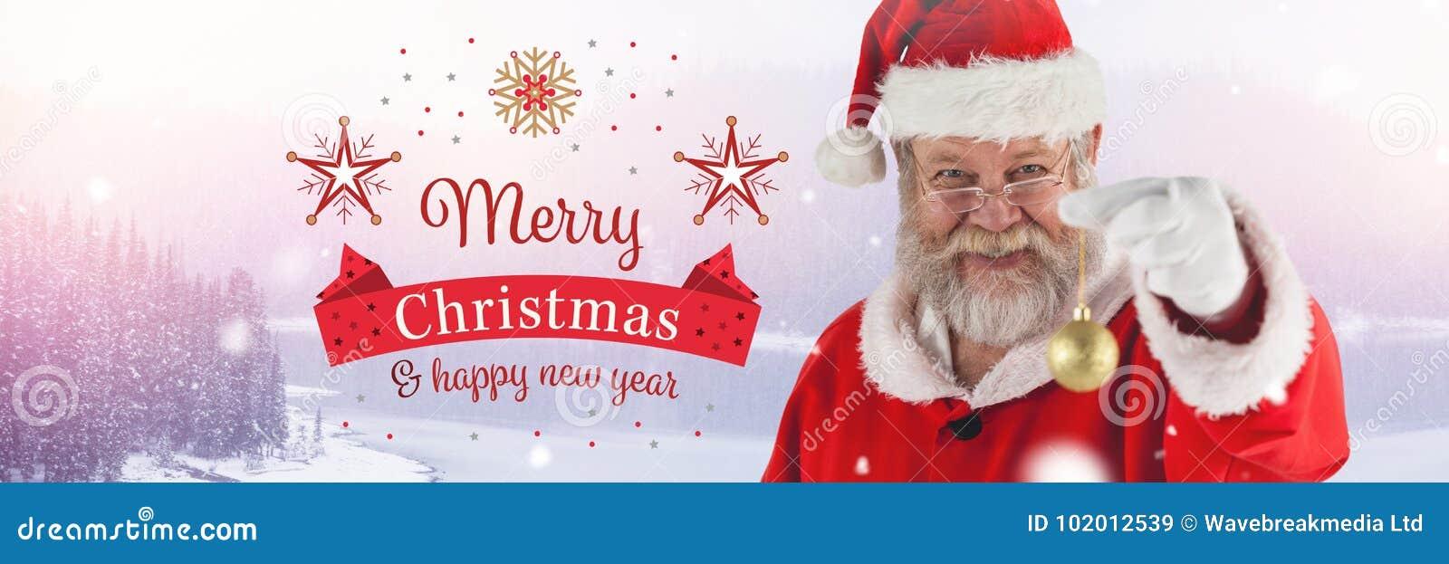 Texte et Santa Claus de bonne année de Joyeux Noël en hiver avec la décoration de babiole de Noël