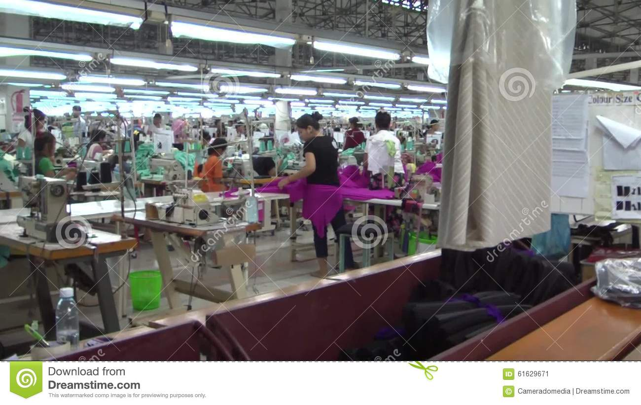 Textile Garment Factory Workers MS Pan From Worker Bundling To Floor Stock Video