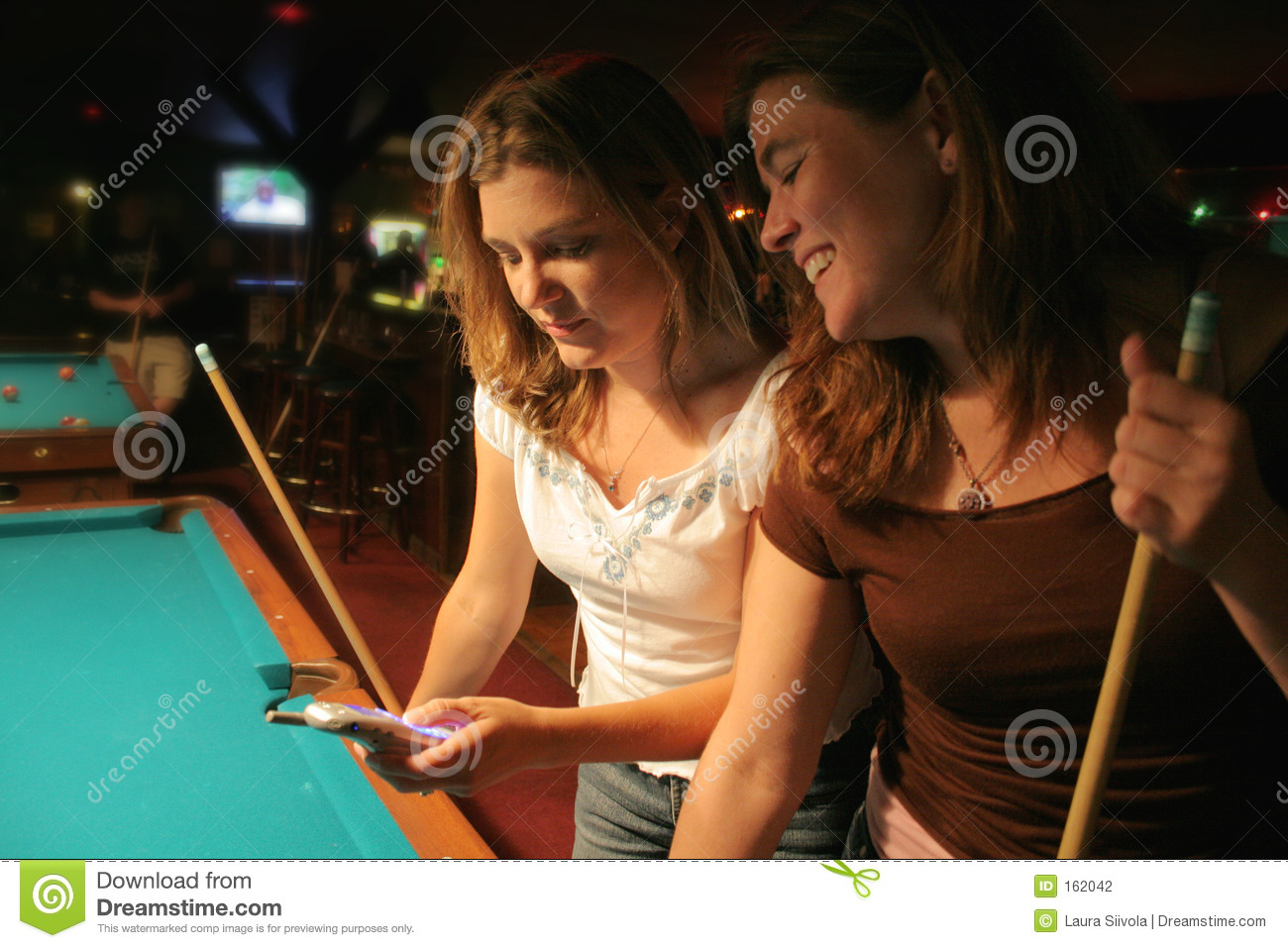 Texting at the pool hall