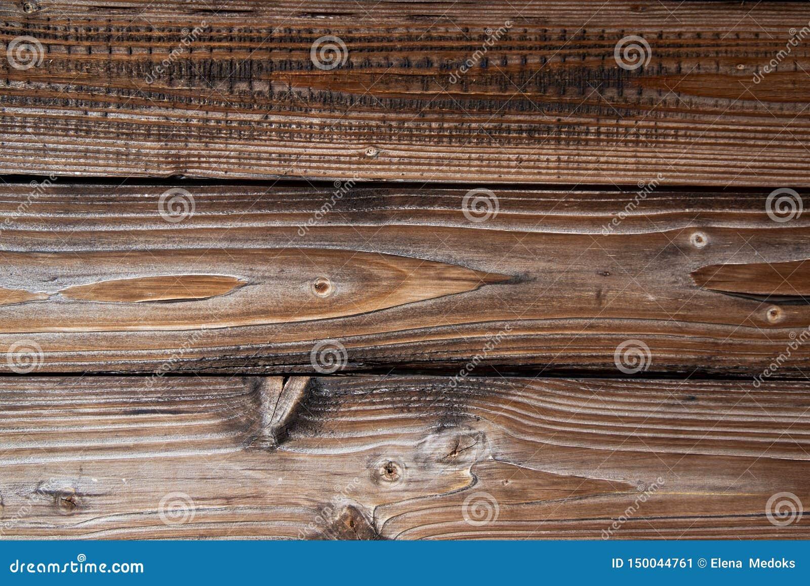 Textur av åldrades gamla träbräden av den bruna åldern modell