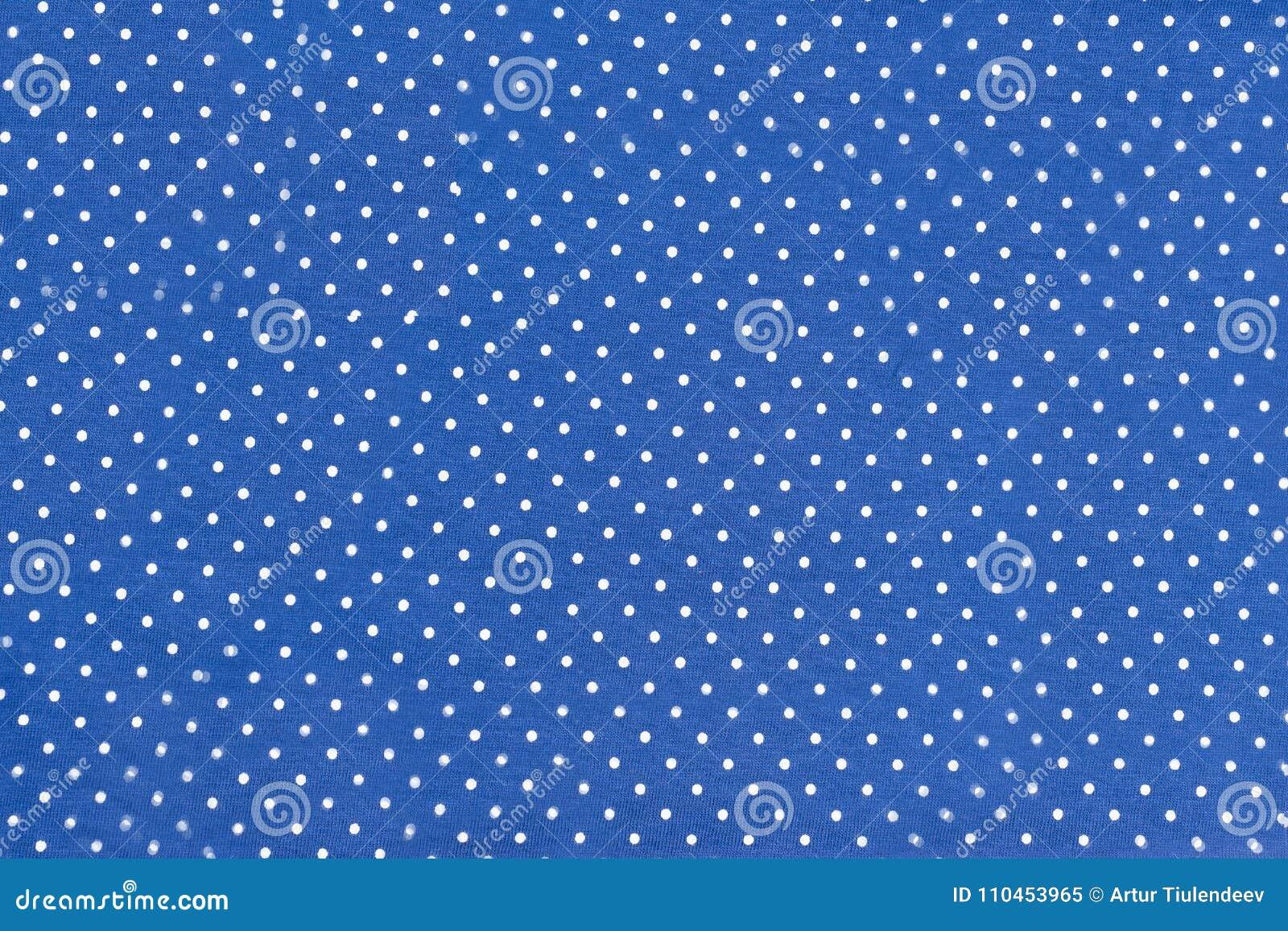 Textur av blått tyg i ärtor