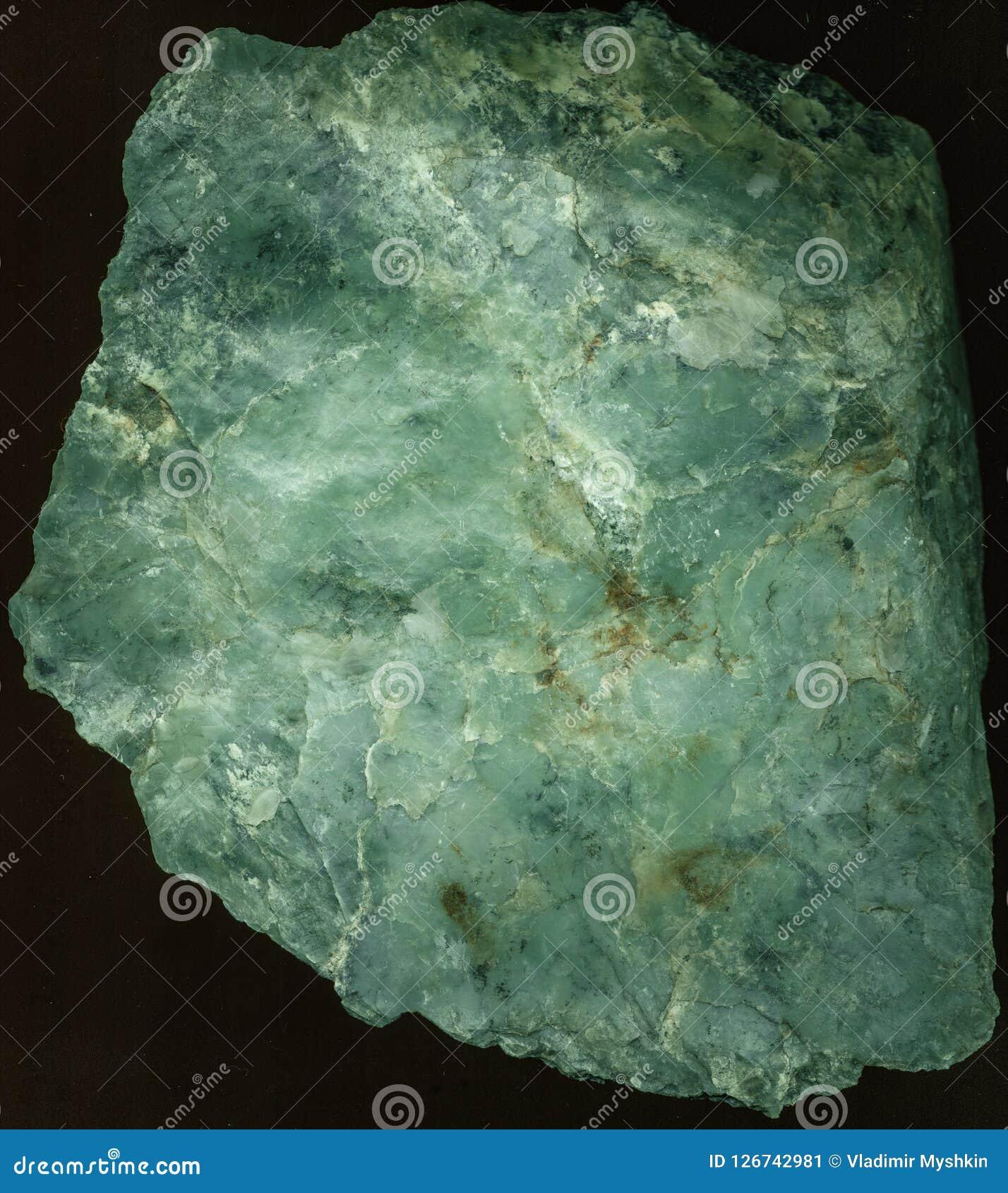 Textur av den gröna stenen som skjutas från över