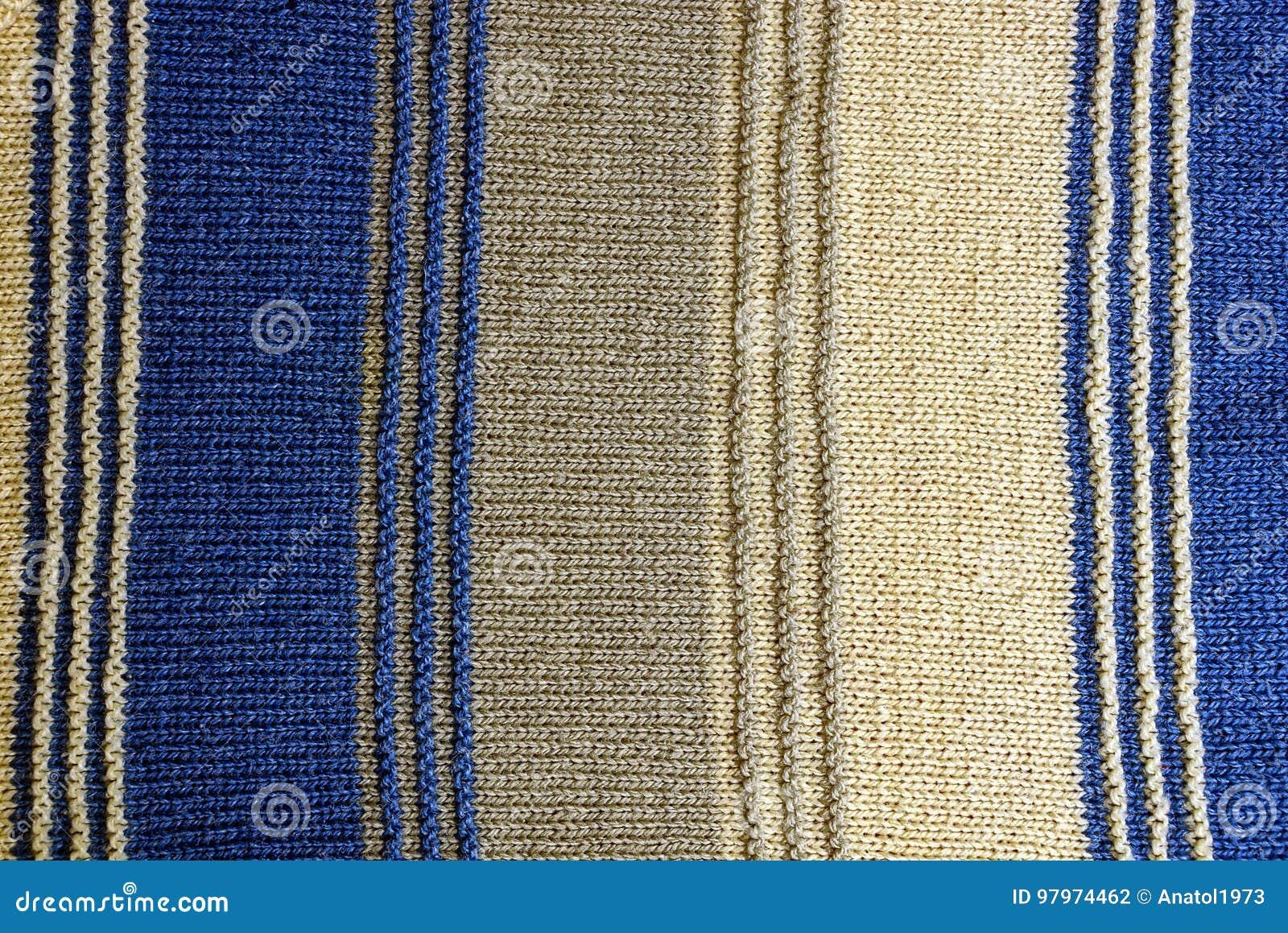 Textur av ett stycke av den woolen tröjan med band