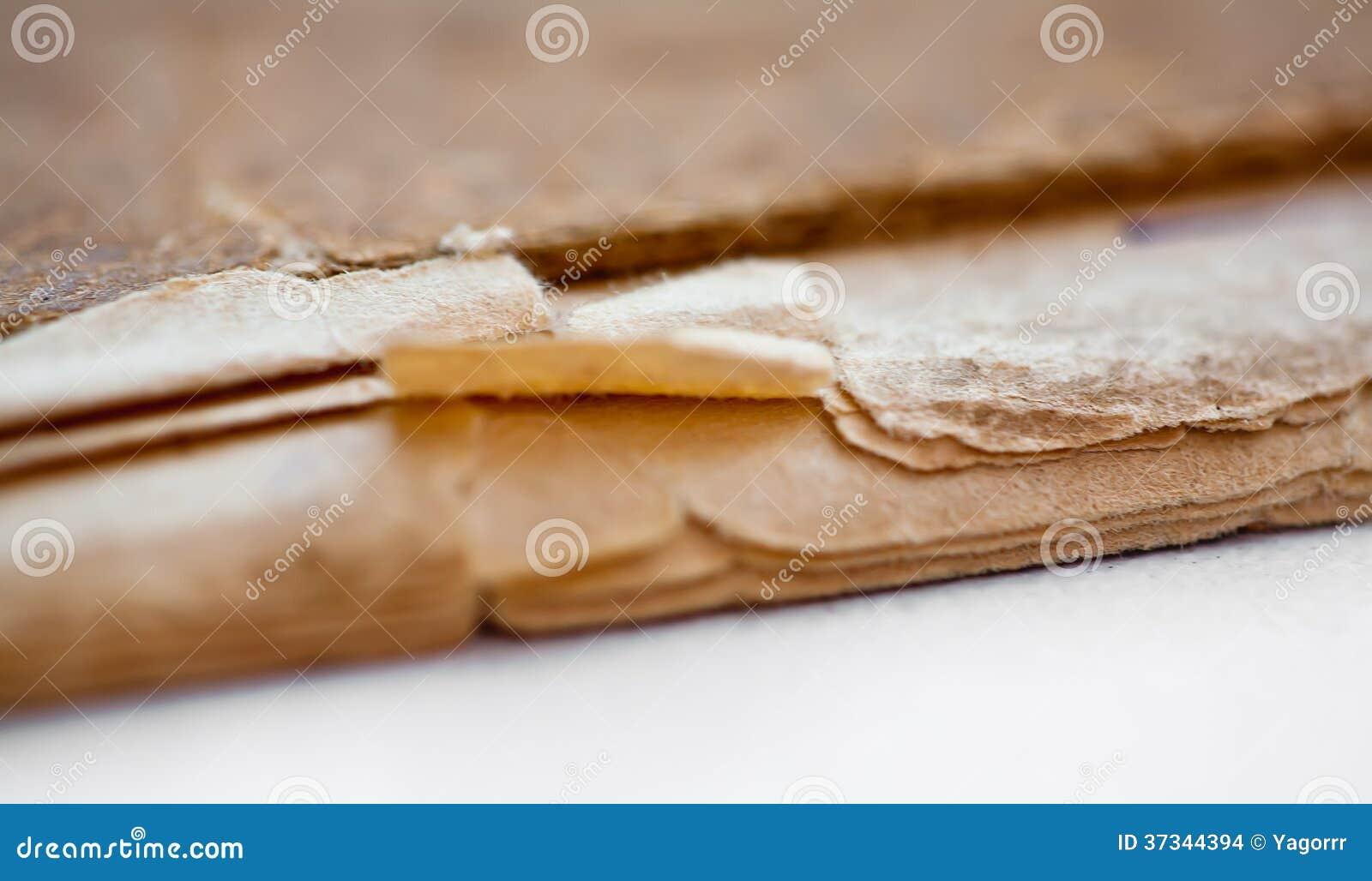 Textur av gamla gulnade sidor avslutar, slet böcker