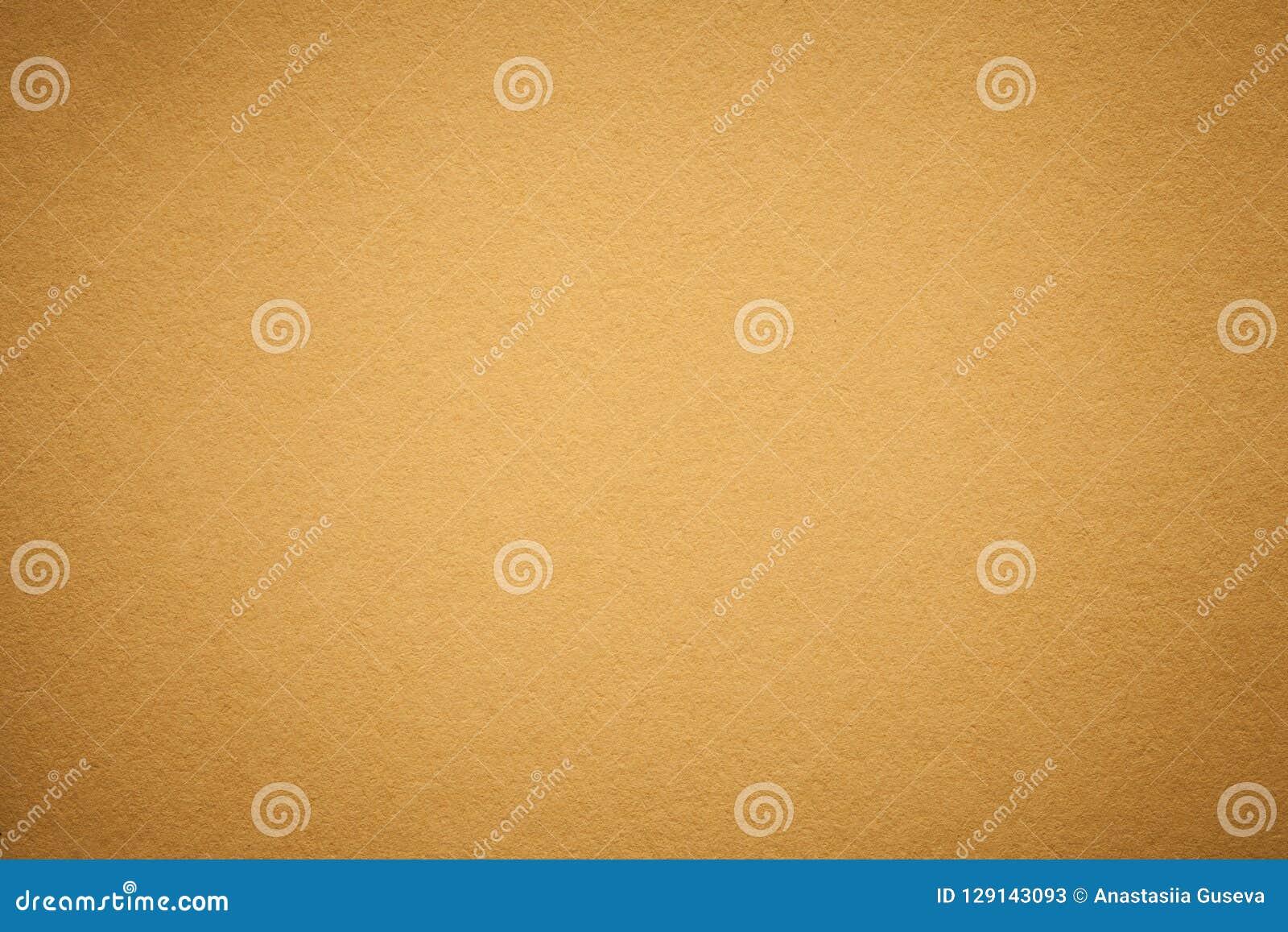 Textur av gammal guld- pappers- bakgrund, closeup Struktur av tätt ljus - orange papp