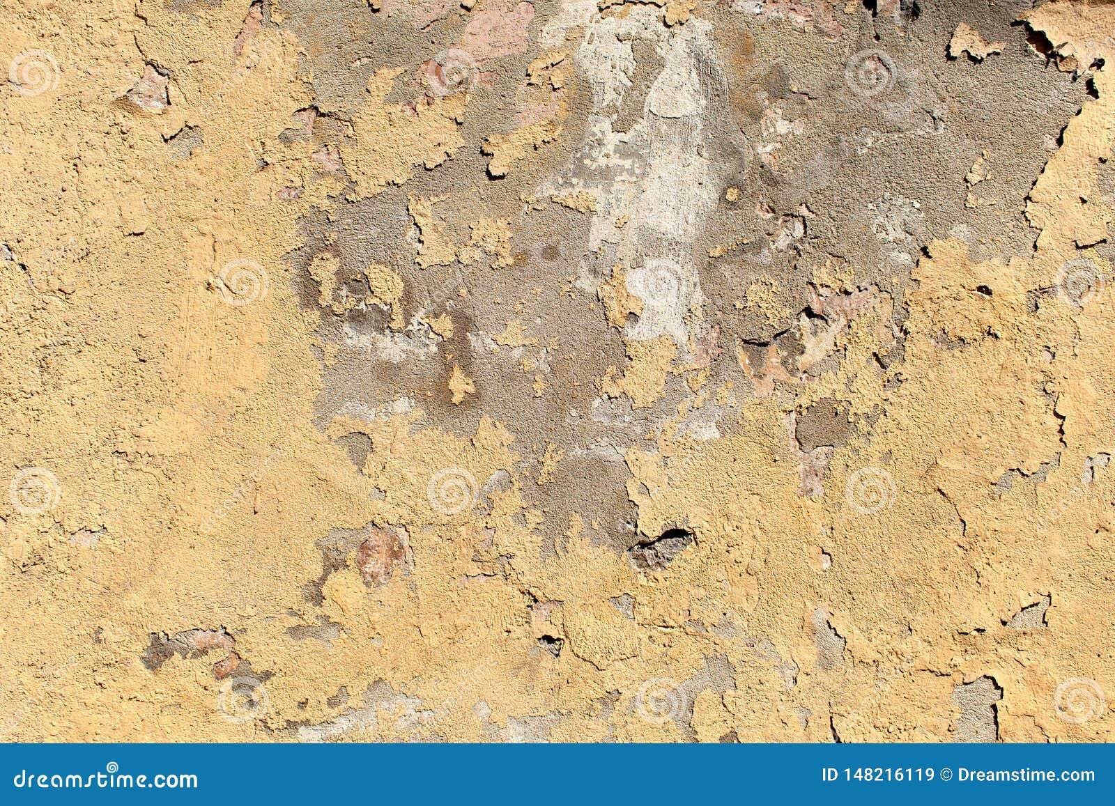 Textur av gammal skalande beige väggyttersida
