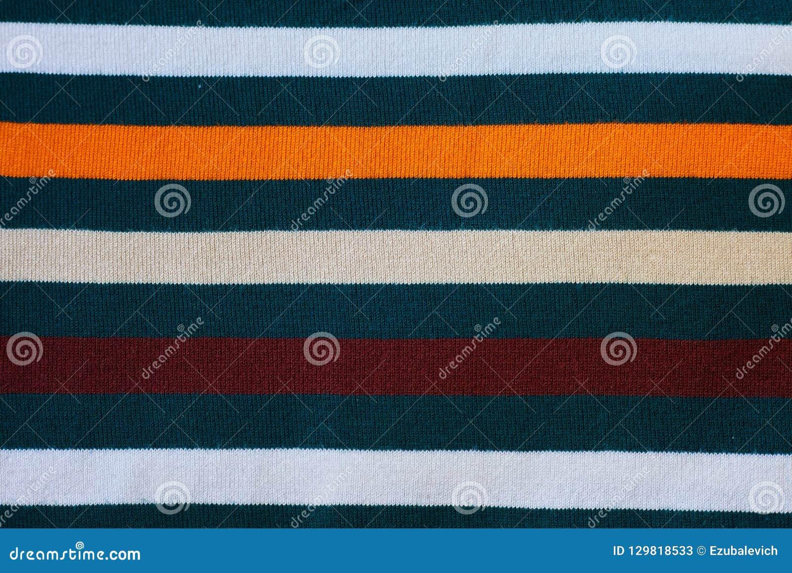 Textur av varm stucken randig kläder