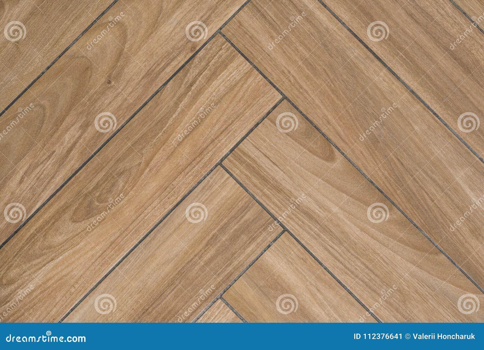 Textur för ekträ av golvet med tegelplattor som imiterar ädelträdurken Traditionell fiskbensmönstermodell