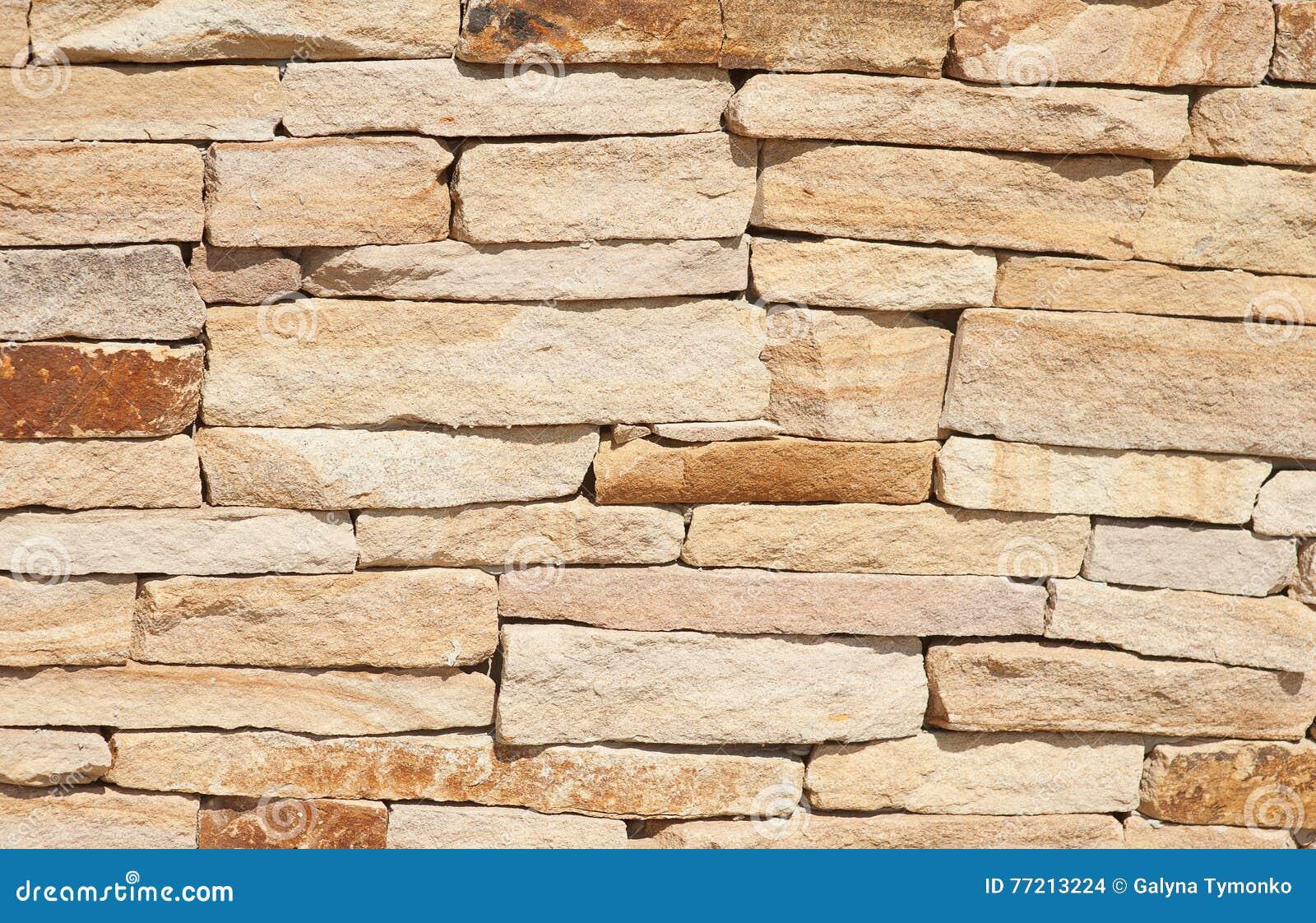 textura spera natural de la pared de piedra para el fondo foto de archivo