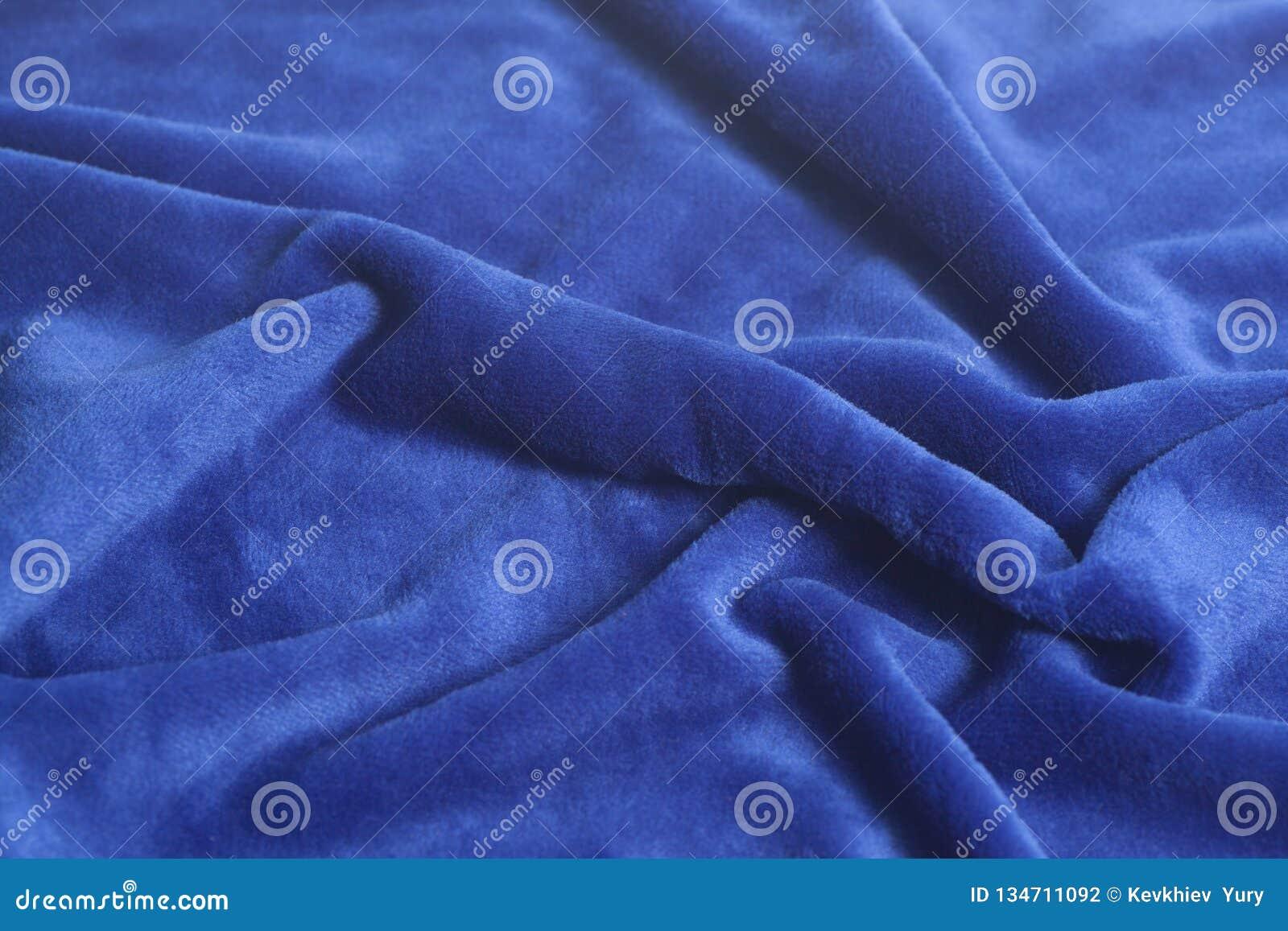 Textura azul del fondo de la tela del terciopelo
