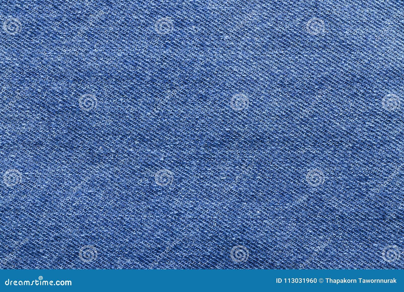 Textura azul del fondo de los vaqueros del dril de algodón