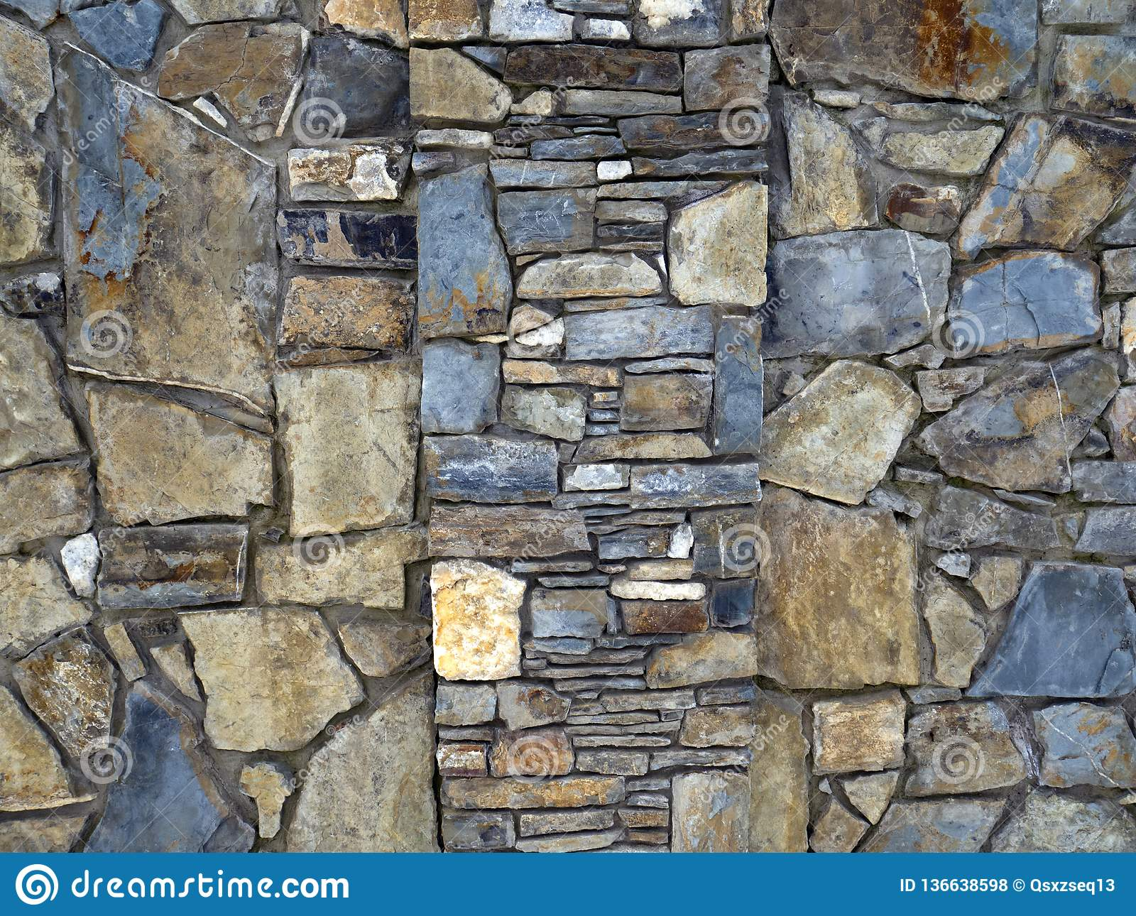 A textura da parede pavimentada com pedra