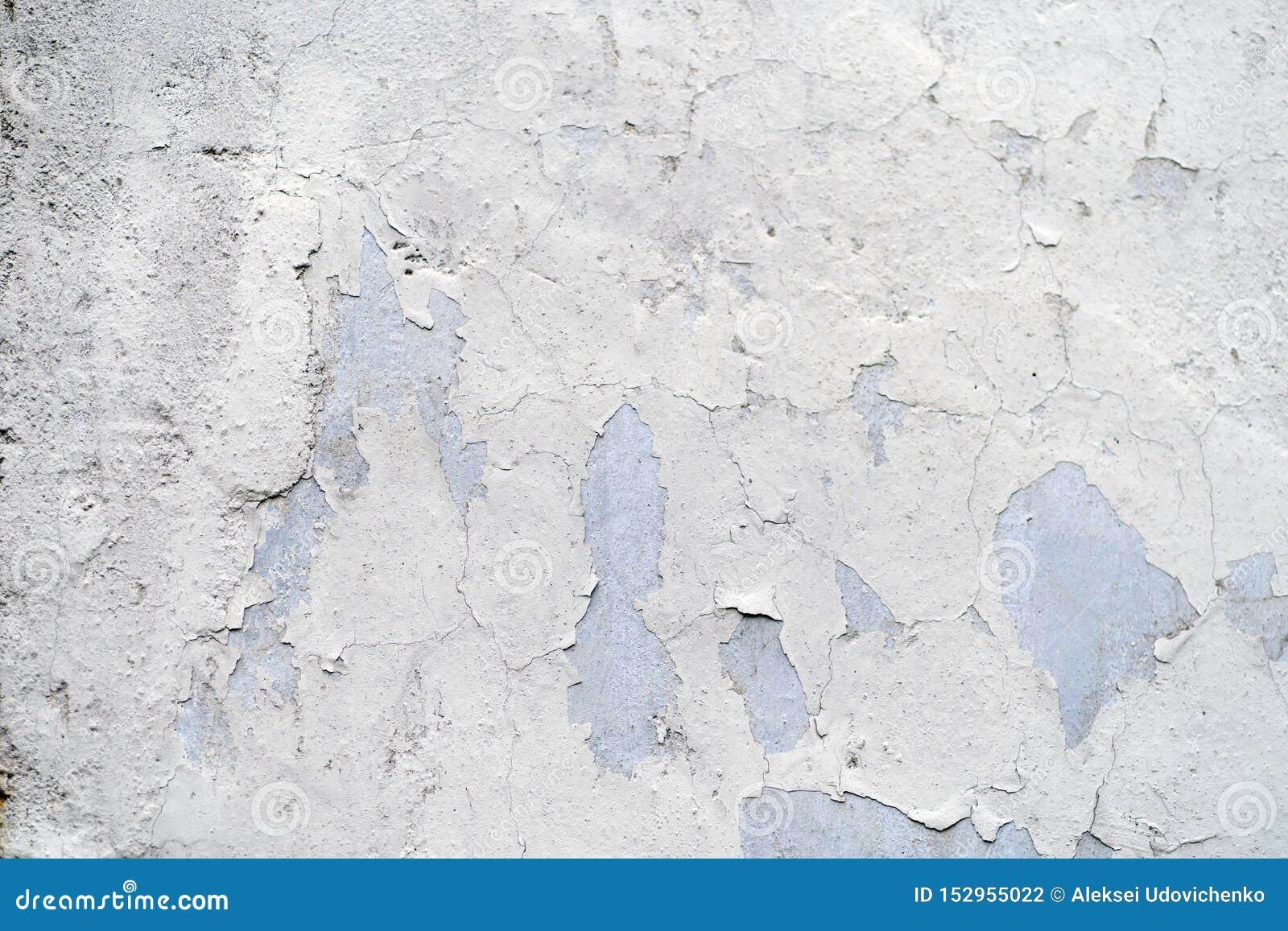 Textura da parede velha do vintage com pintura rachada