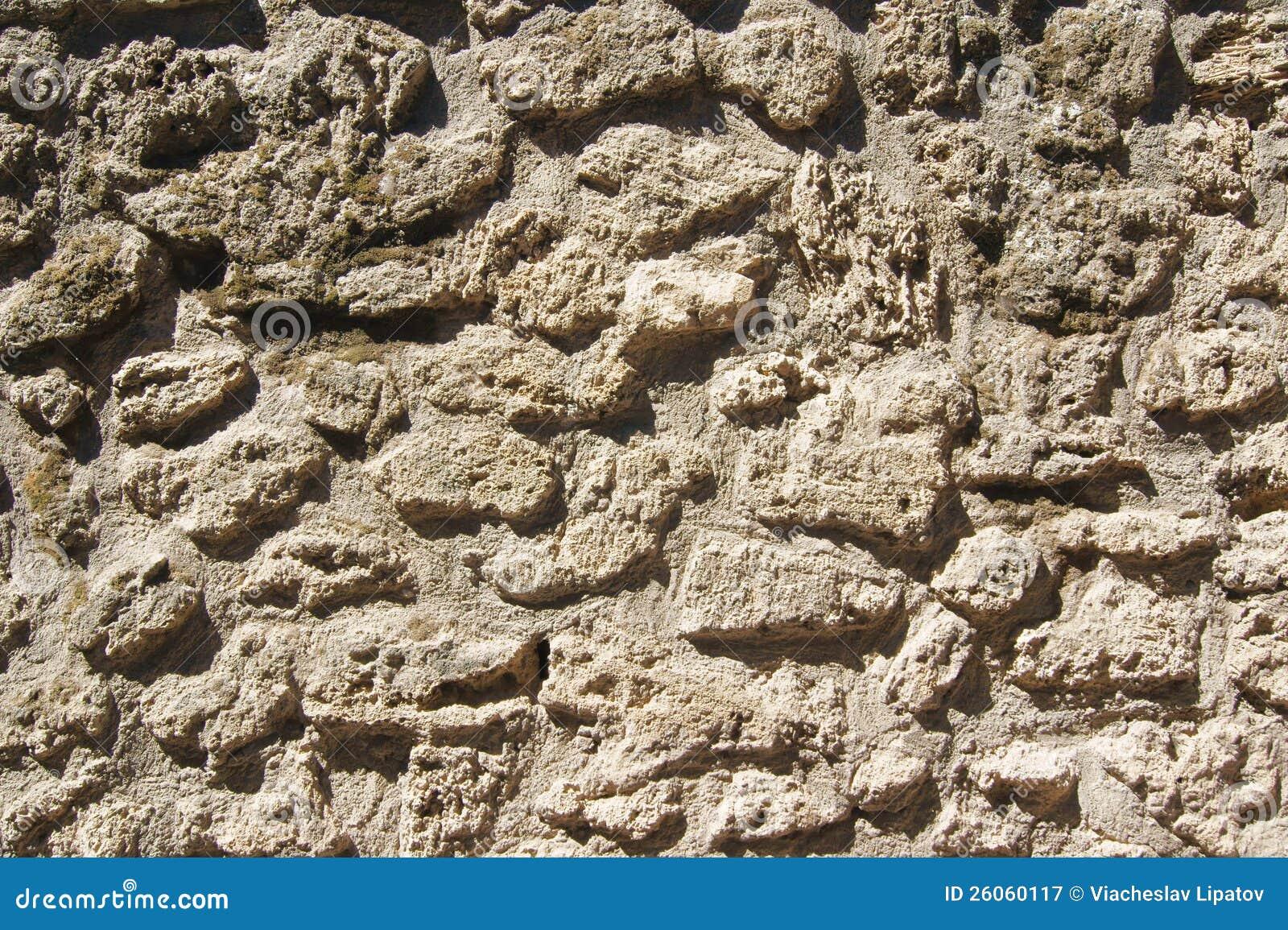 A textura da pedra antiga da lava da alvenaria