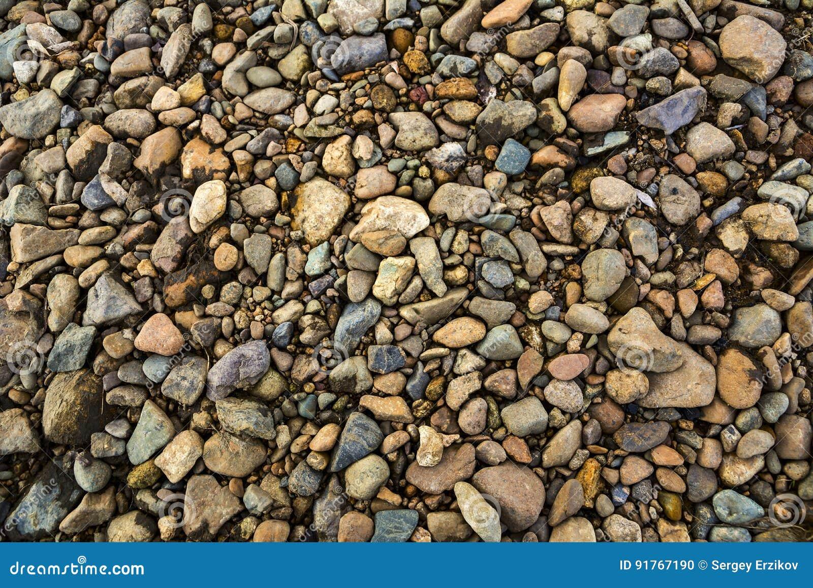 Textura de la grava del color textura de las piedras foto for Poner piedras en el jardin