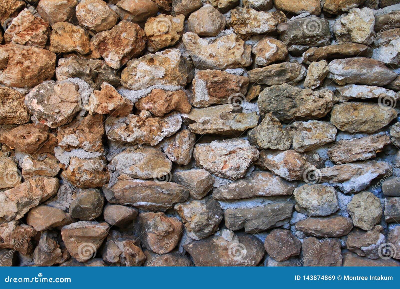Textura de la pared de piedra Una pared de piedra de la casa hacer a mano para el fondo o la textura