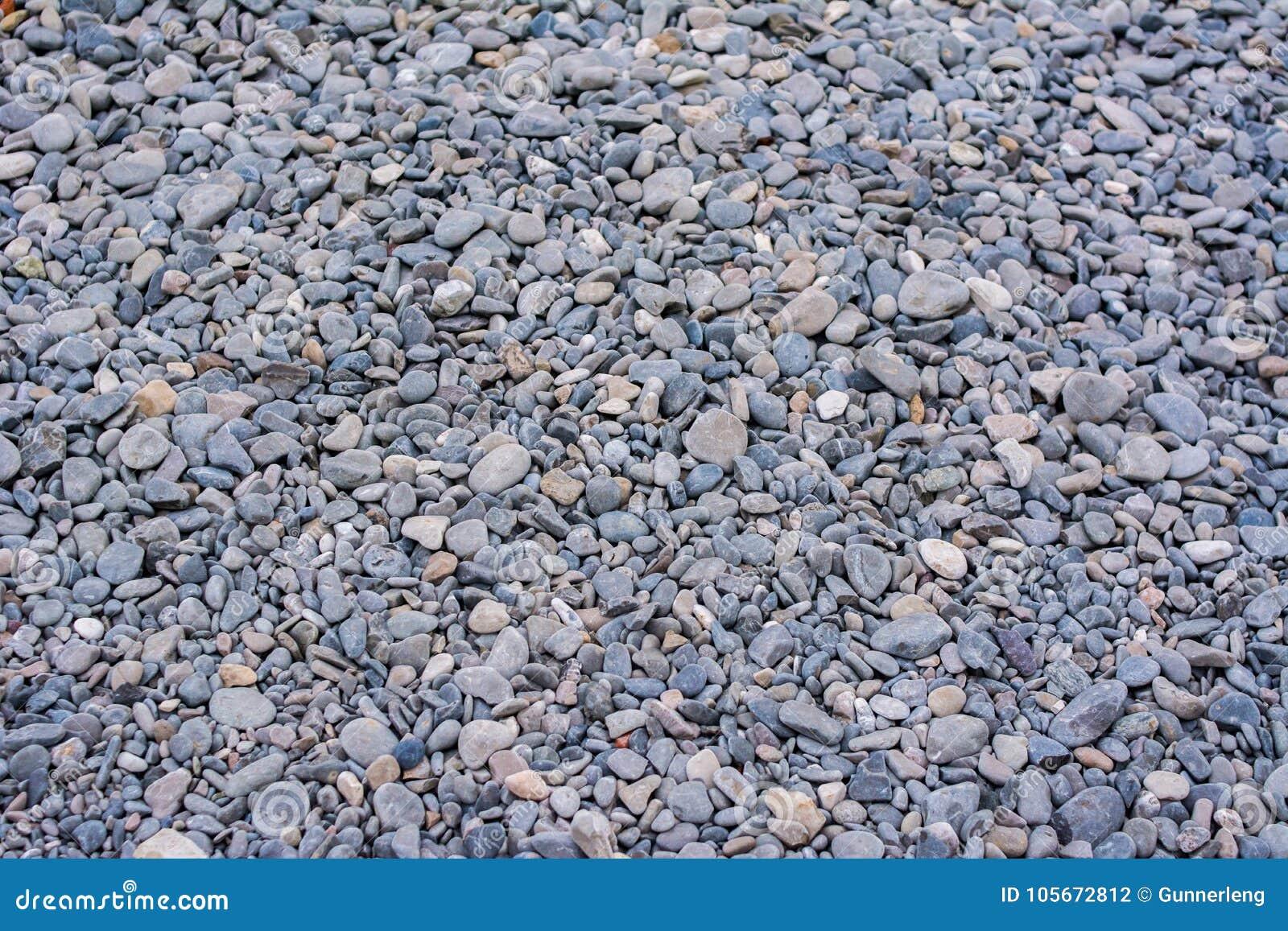 Textura de la pequeña roca de las piedras de la grava gris