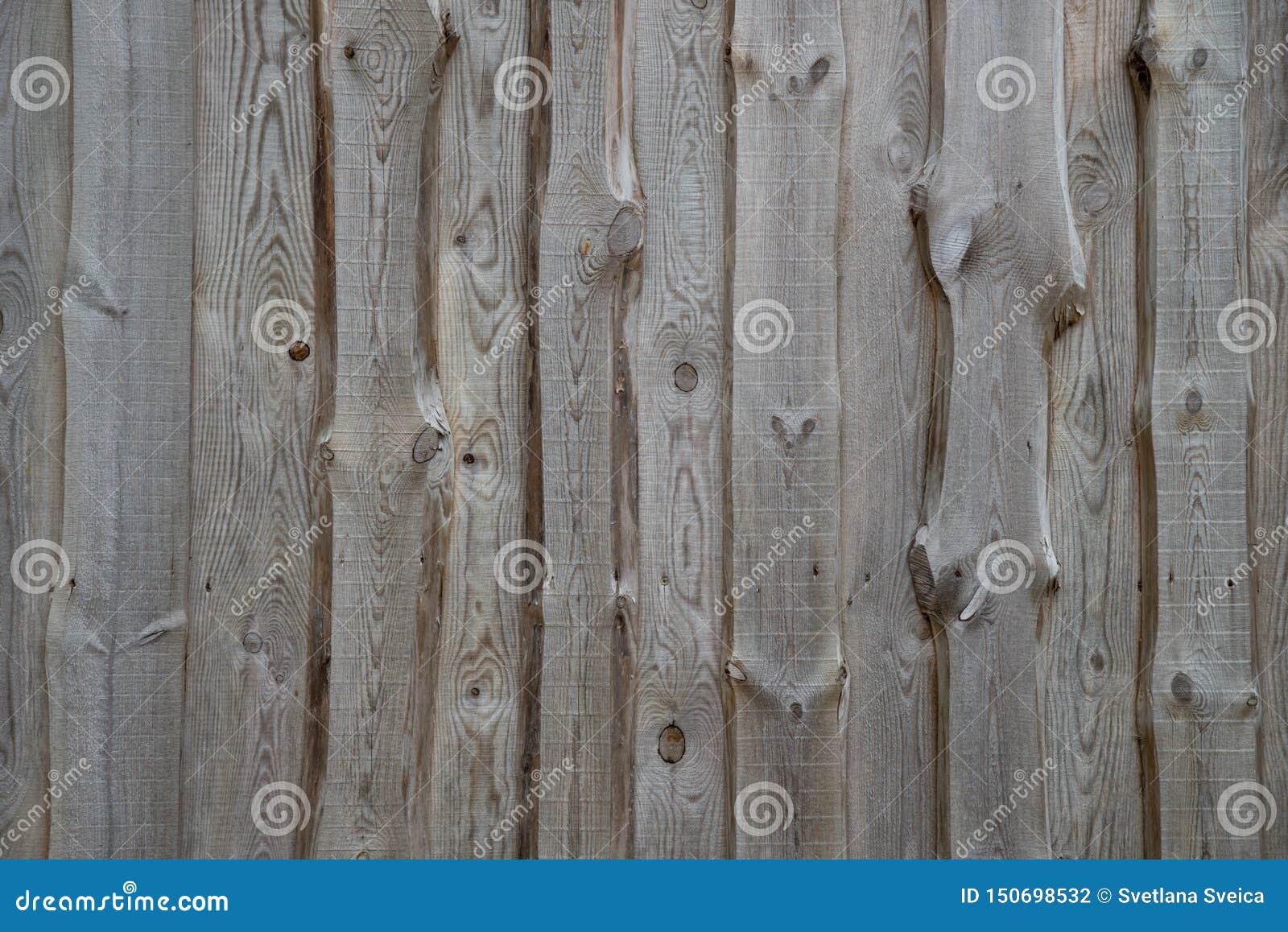 Textura de madera del fragmento de la fachada de la pared