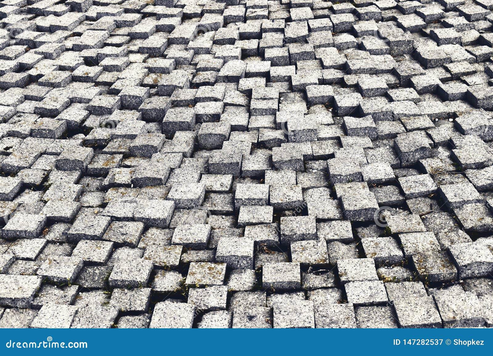 Textura de pedra do pavimento Fundo apedrejado godo do pavimento do granito Fundo abstrato do close-up velho 2 do pavimento da pe