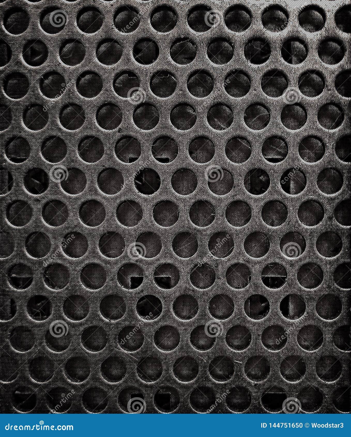 Textura del Grunge del fondo de la hoja de metal con los agujeros
