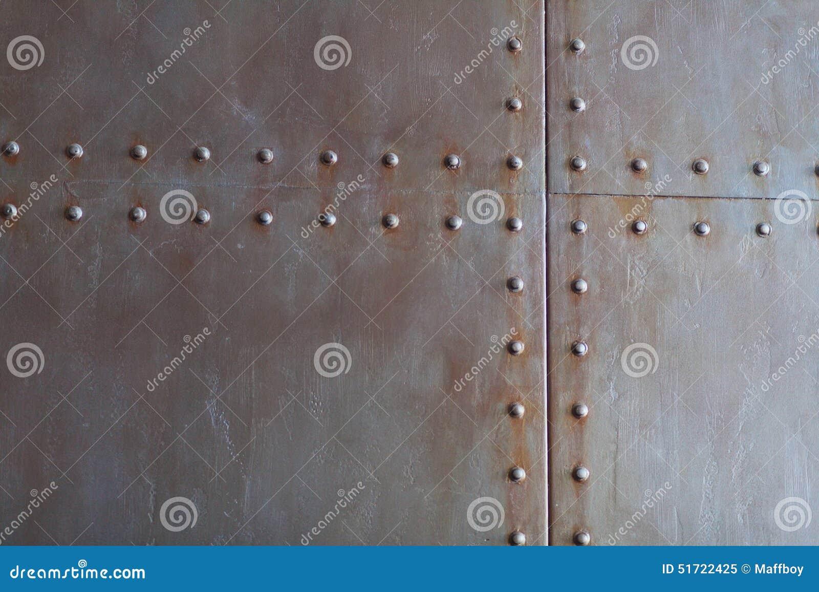 Textura del metal con los remaches