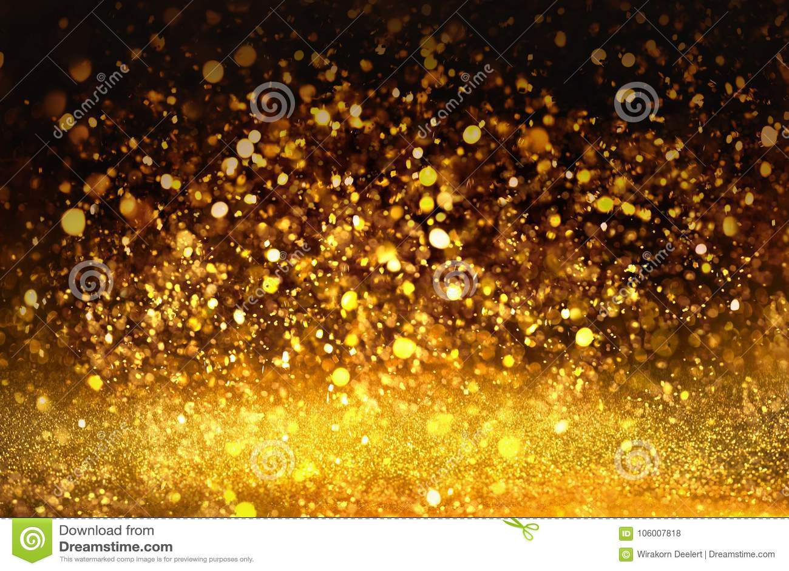 A textura dourada Colorfull do brilho borrou o fundo abstrato para o aniversário, o aniversário, o casamento, a véspera de ano no