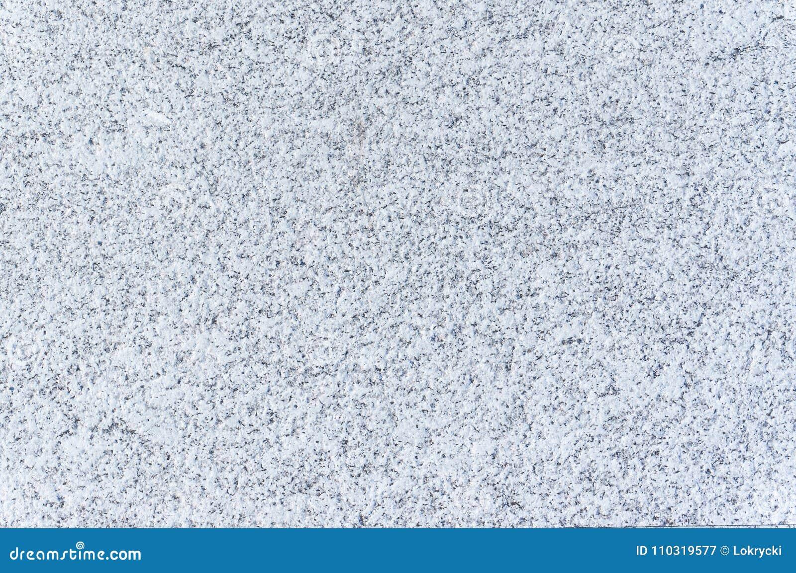 Textura granosa del primer de la pared de piedra que pone en contraste