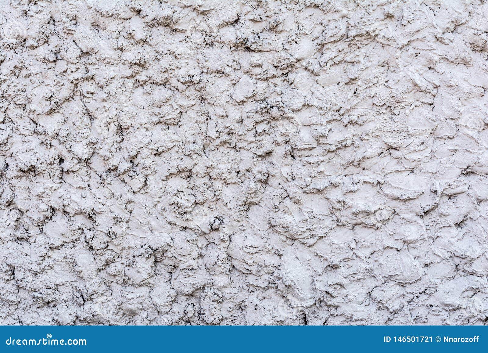 Textura gris de un muro de cemento, capa de yeso decorativo, fondo abstracto