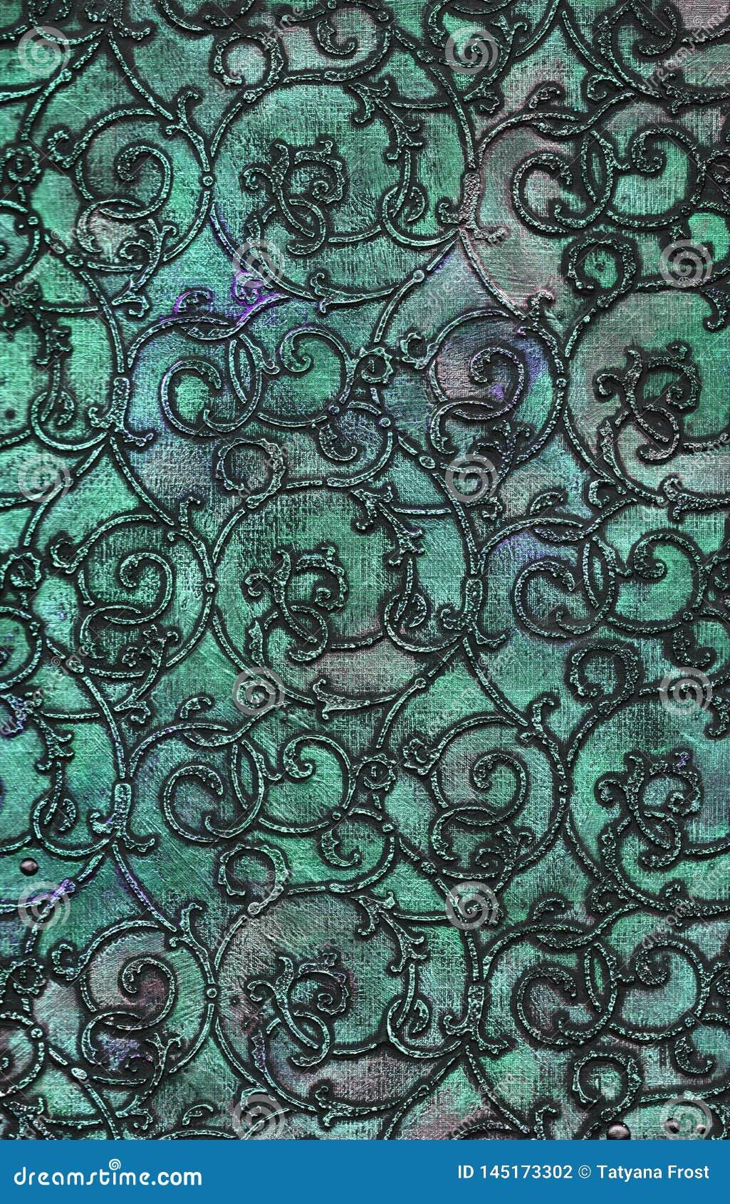 Textura metálica con el modelo del arabesque