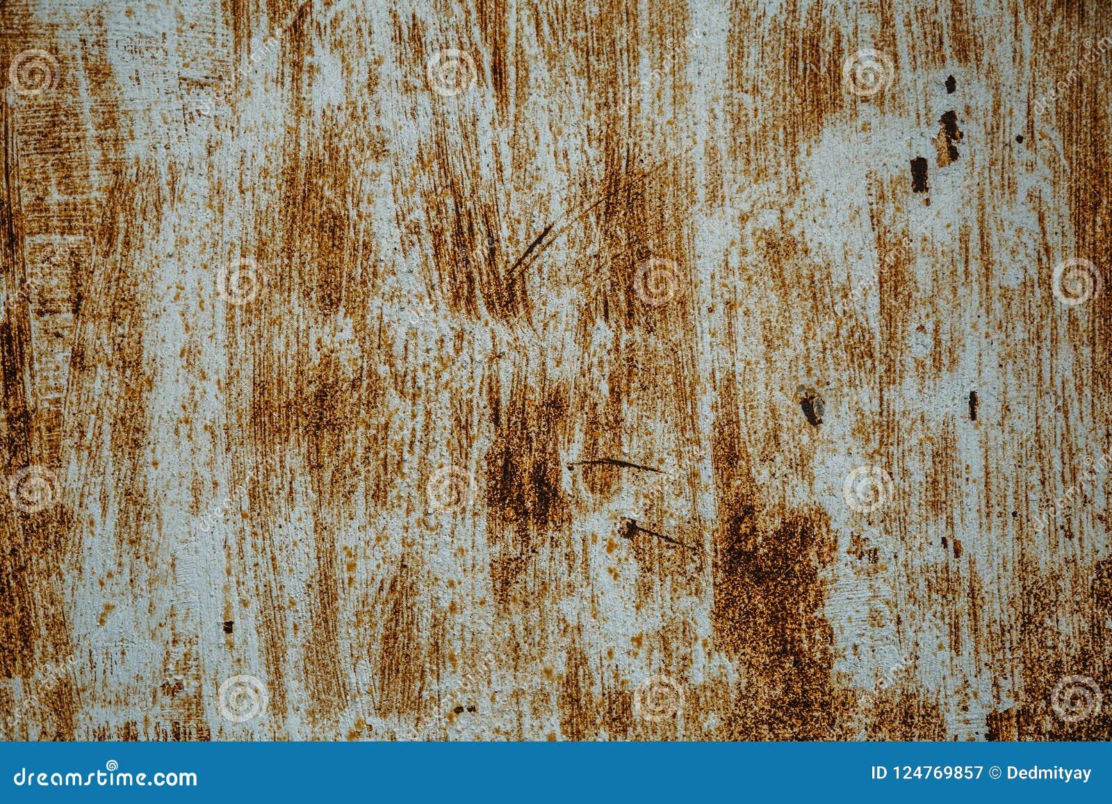 Textura oxidada velha do ferro, pintura riscada na superfície metálica, folha do grunge do metal áspero