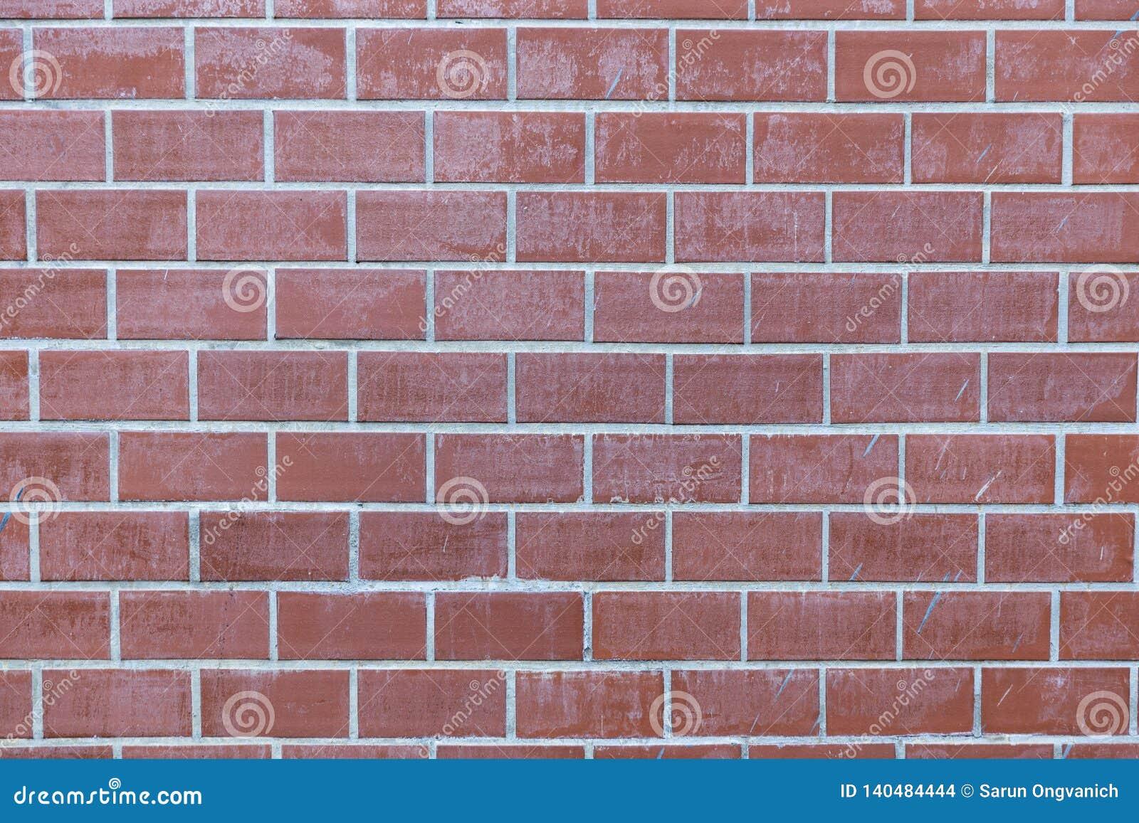 Textura pálida do fundo da parede de tijolo vermelho