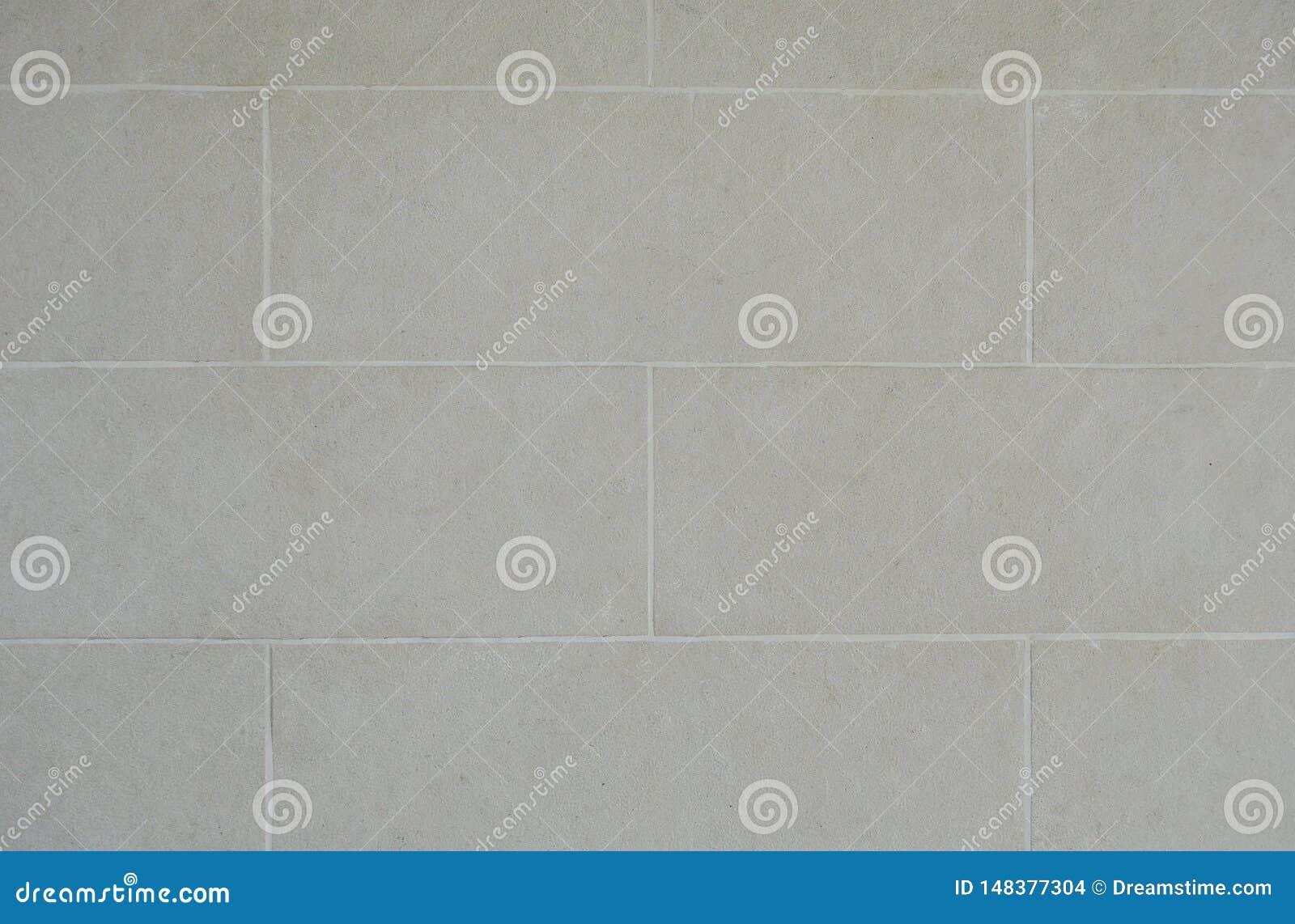 Textura pintada blanco del fondo de la pared del bloque de cemento