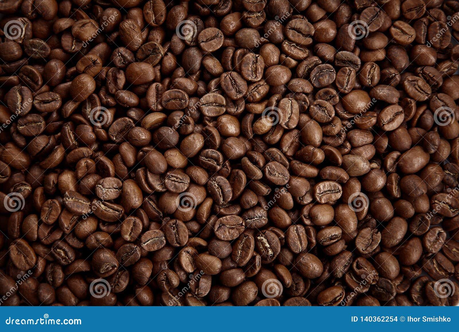 Textura Roasted dos feijões de café Feche acima da vista, vista superior
