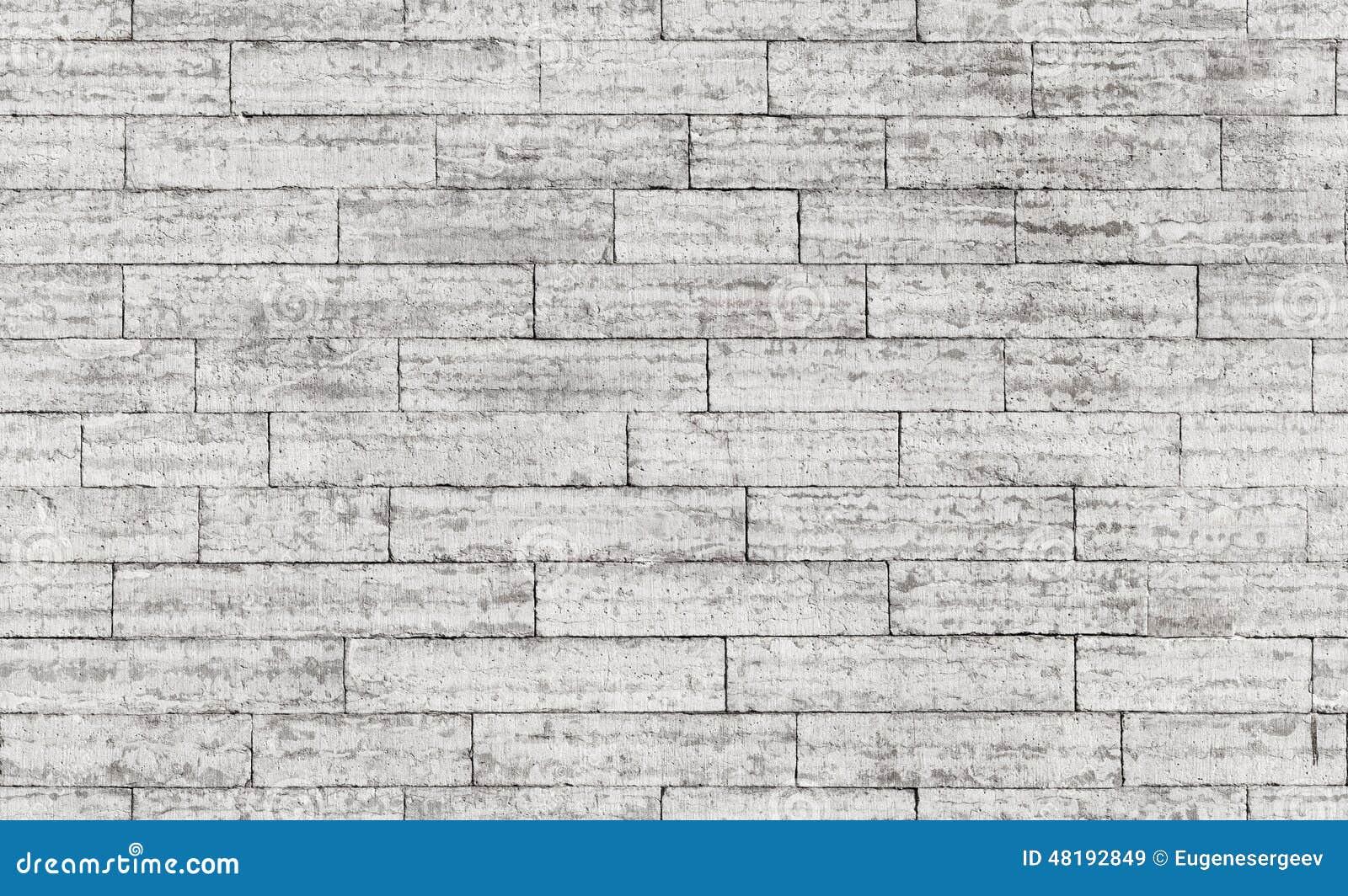 Textura sem emenda do fundo da parede de tijolo de pedra cinzenta