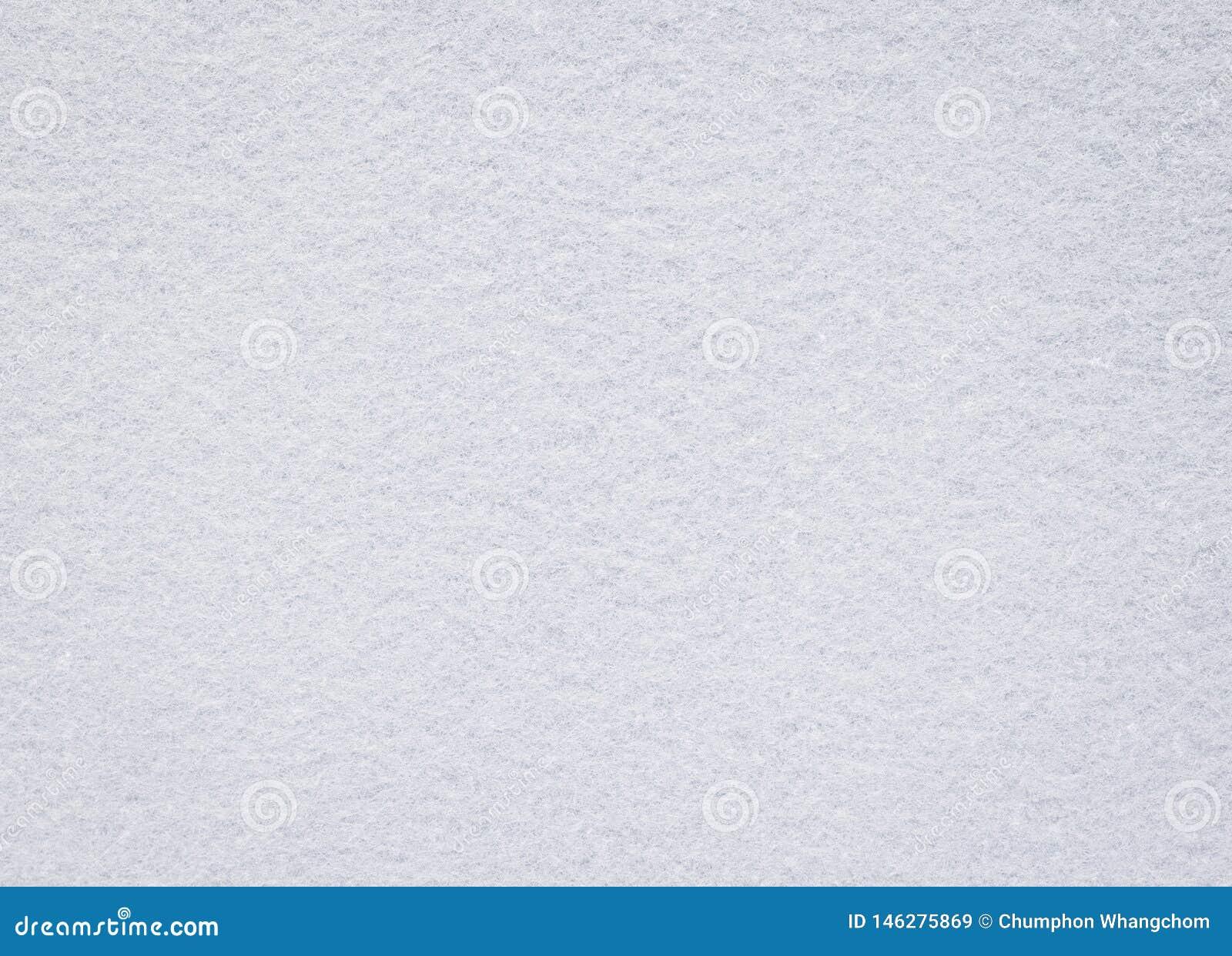 Textura sentida blanca Fondo en blanco de la tela Detalle del material de la alfombra