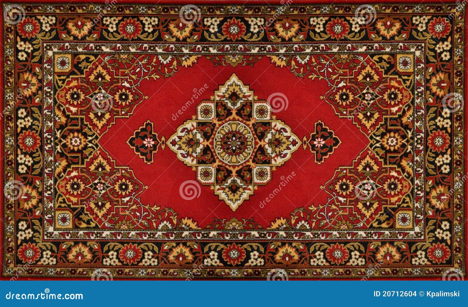 textura tradicional adornada roja de la alfombra foto de