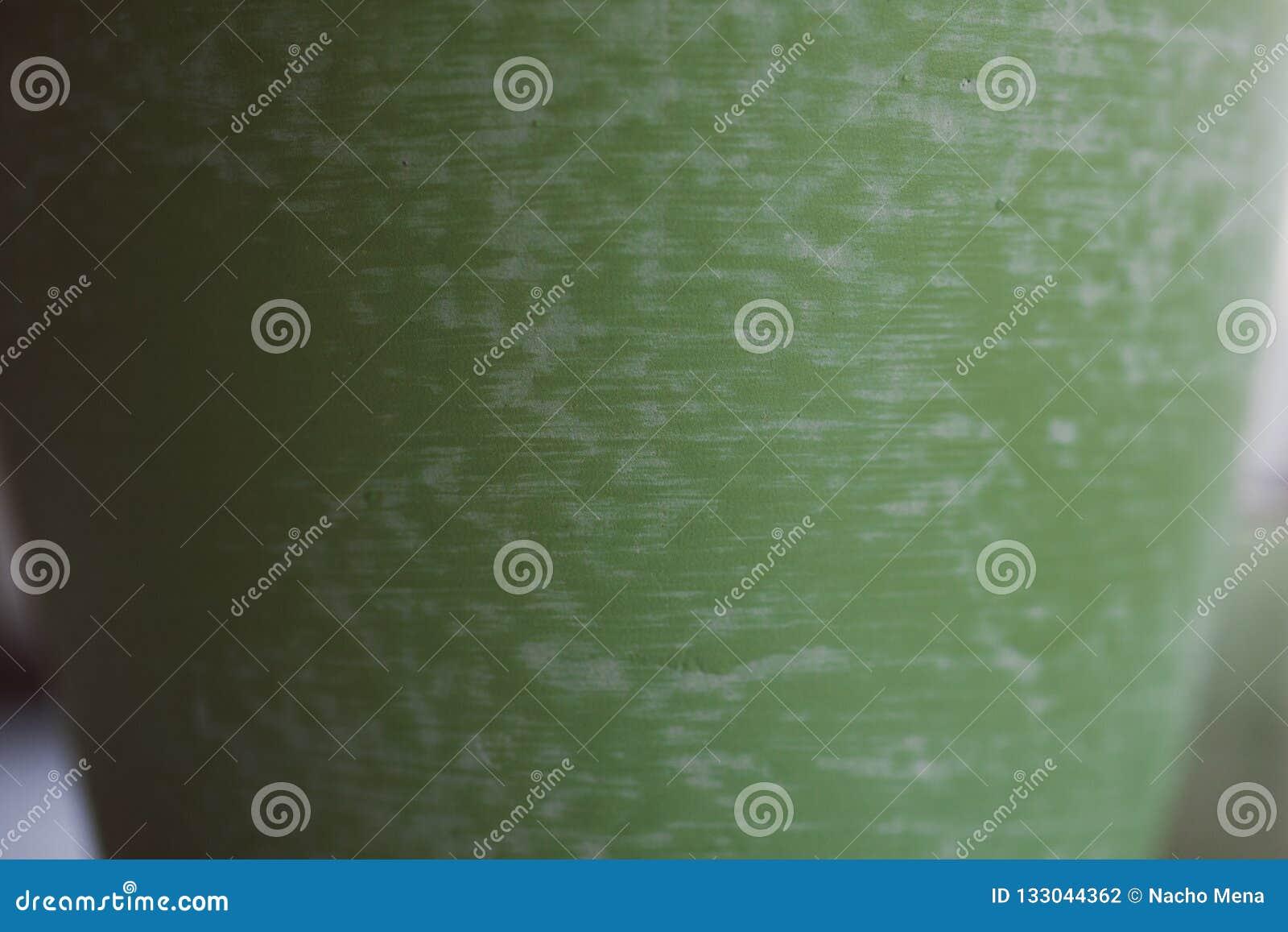 Textura verde de la cerámica hecha a mano Vista ascendente cercana de la superficie de cerámica verde