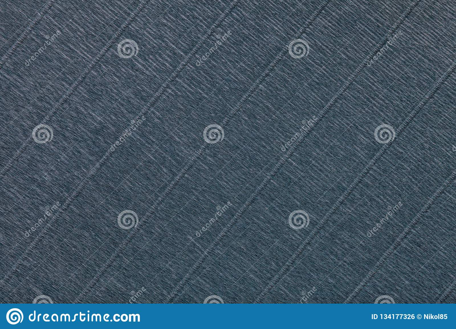 Textural of dark gray background of wavy corrugated paper, closeup