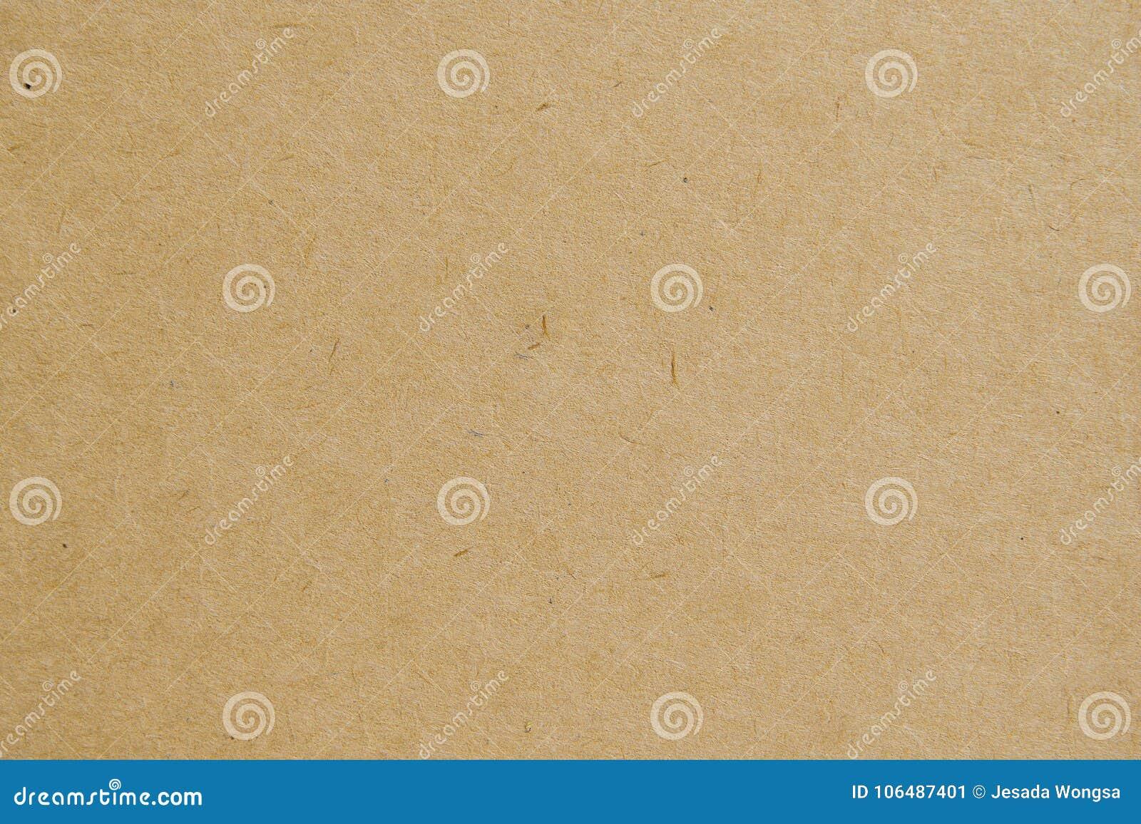 Texturbakgrund för brunt papper använder oss designen för kraft brevpapper- eller paperboardbakgrund