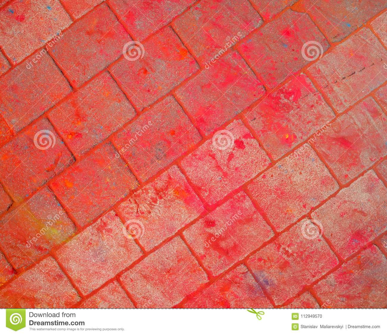 The texture of the asphalt. Multi-colored stains, splashes and traces of paint dry.