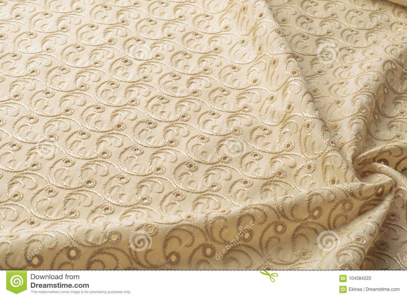 Texture background of fabric. Beige fabric with punctured circle