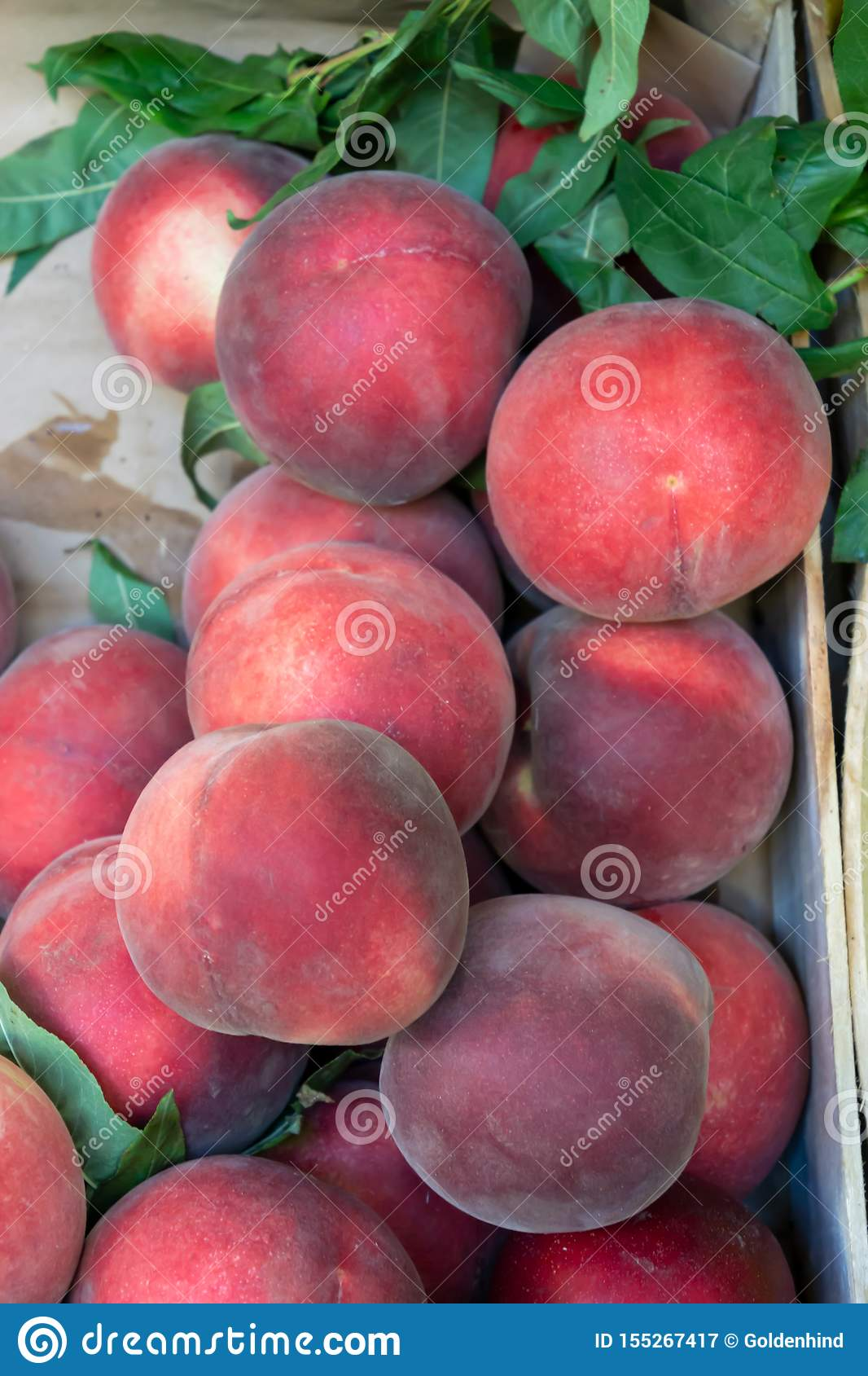 Texture background of fresh organic sweet red ripe peaches at the street market