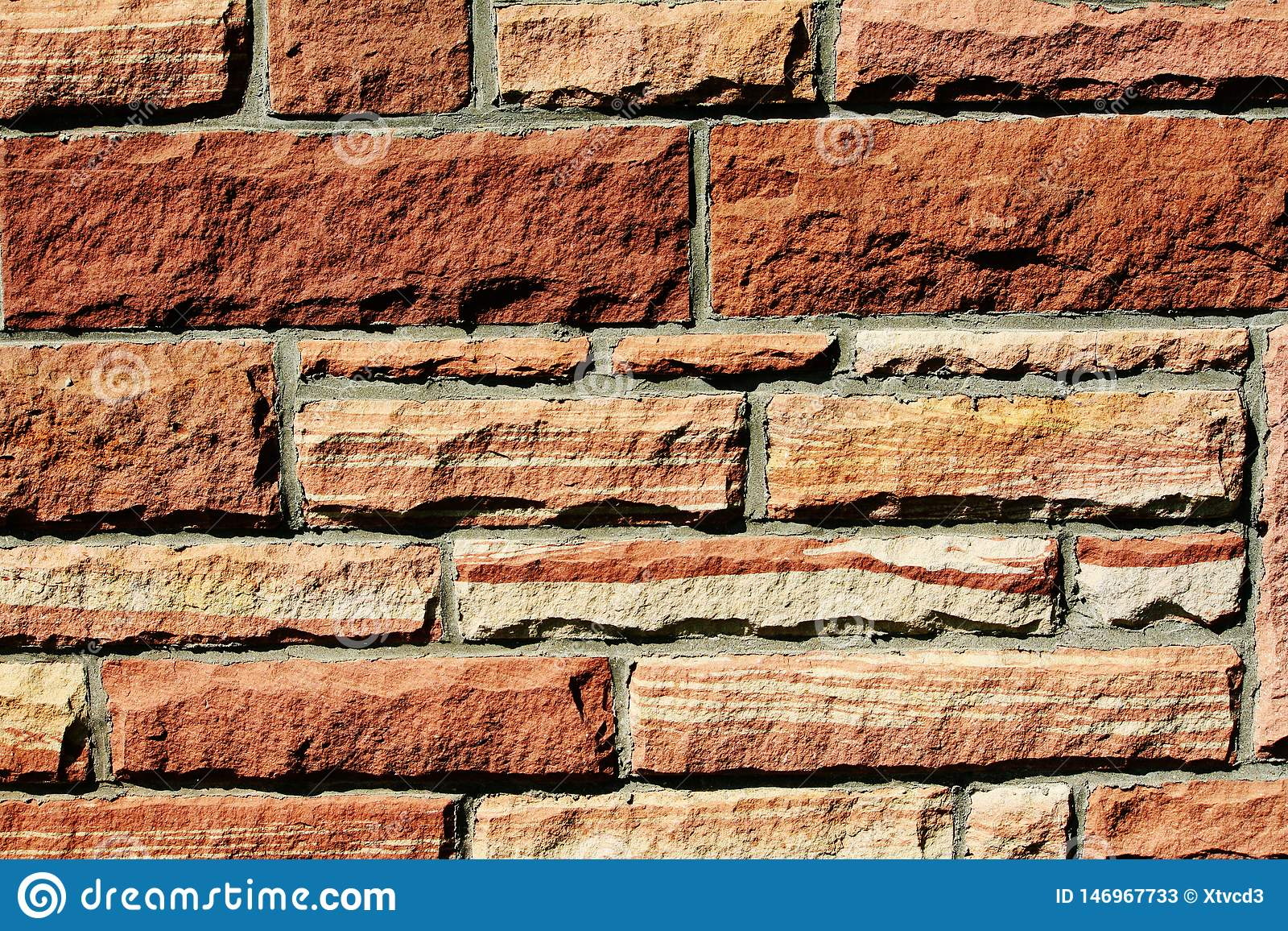 Texture background of a red sandstone wall
