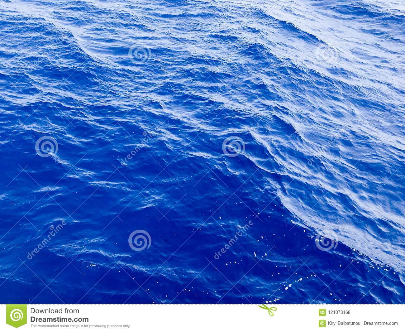 The texture of a beautiful voluminous picturesque azure blue sea, ocean salty calm wet water with waves, ripples on the water. Aqu