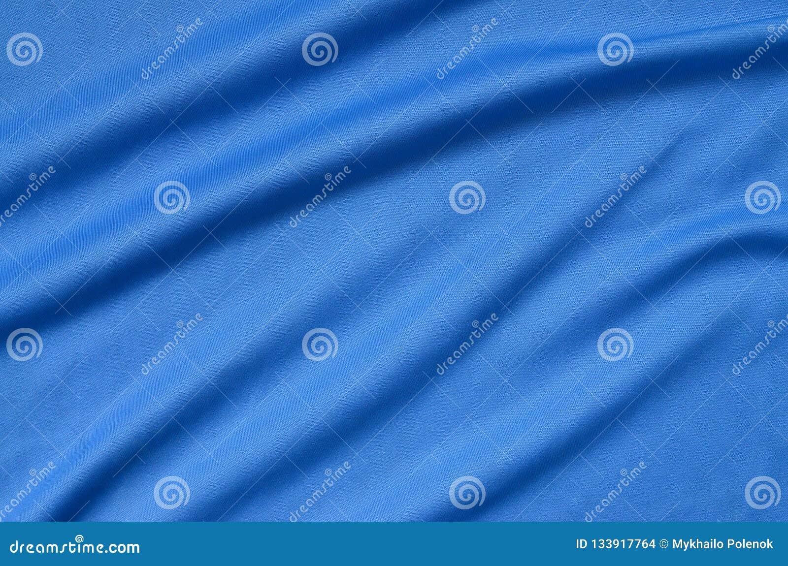 Texture bleue de tissu de polyester détaillé avec beaucoup de plis